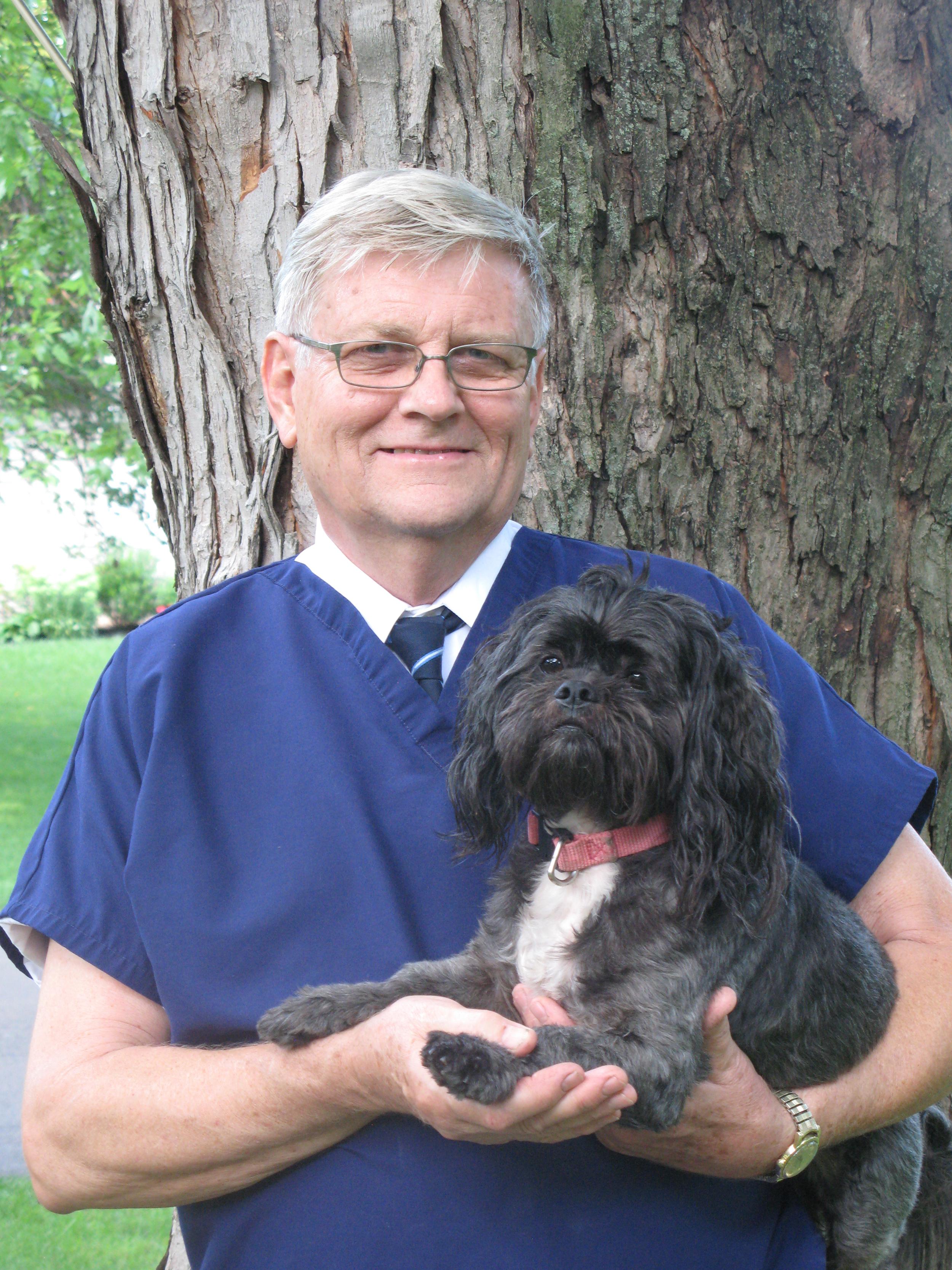 Dr. David Hopps, BVSC, PhD and his dog, Galen