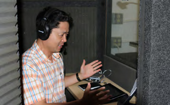"John, the voice of Youthbytes in Mandarin, in the studio dubbing the program. He said "" Oh, it is easy to do Chad's voice; he speaks as fast as most Chinese people!"""