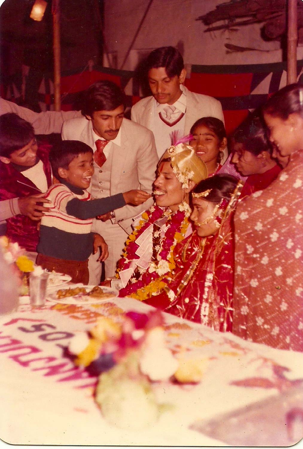 A picture from my parents' wedding album which surely seems candid. The photographer would be called a traditional photographer today.