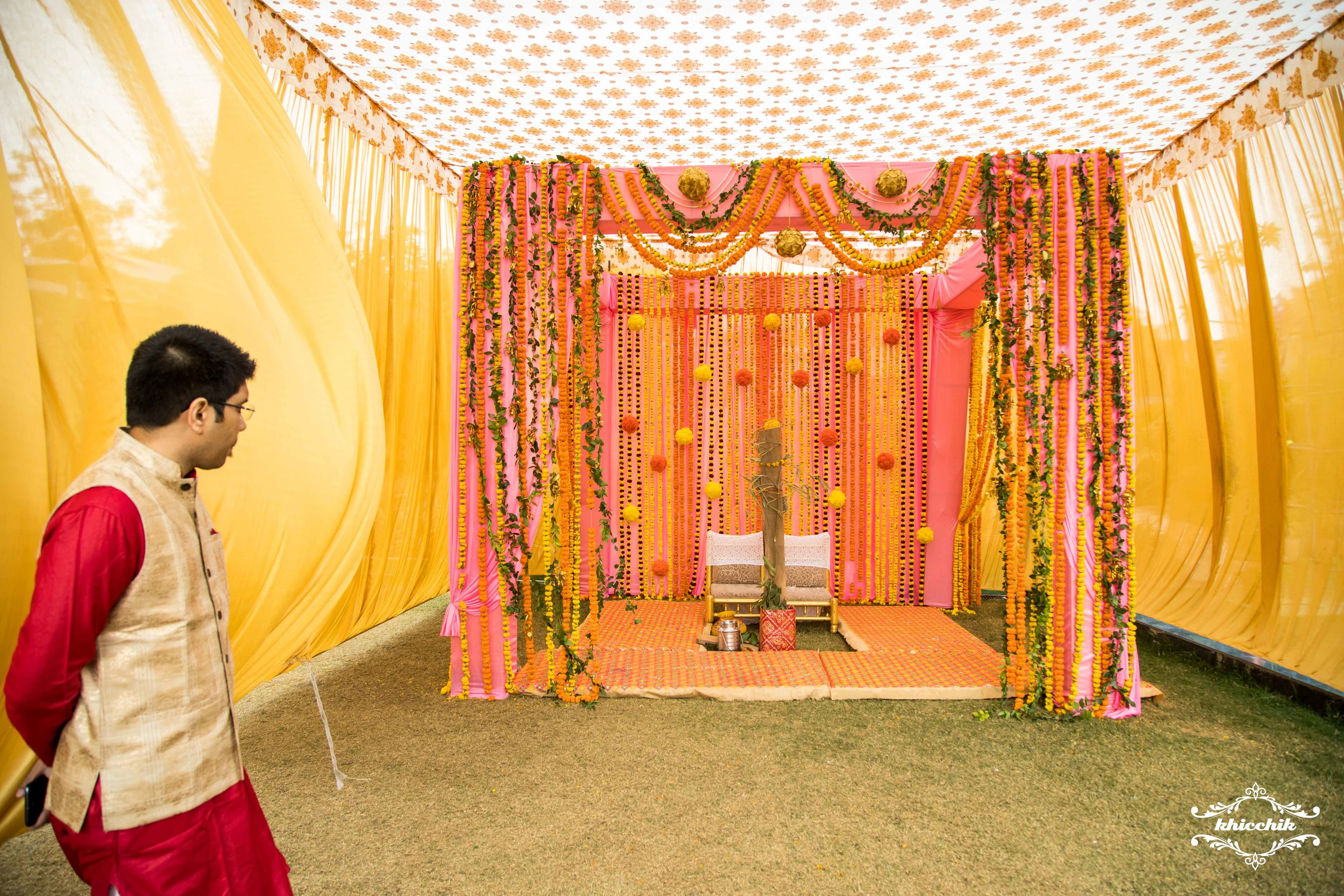 The mandap being looked after by Roli's brother-in- law as he was one of the first ones to arrive and oversee the decorations.
