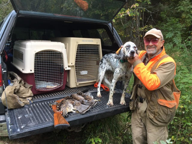 Phil Caputo with English Setter Skye and three dead grouse, in the Upper Peninsula of Michigan.  Credit: Mike Ballard