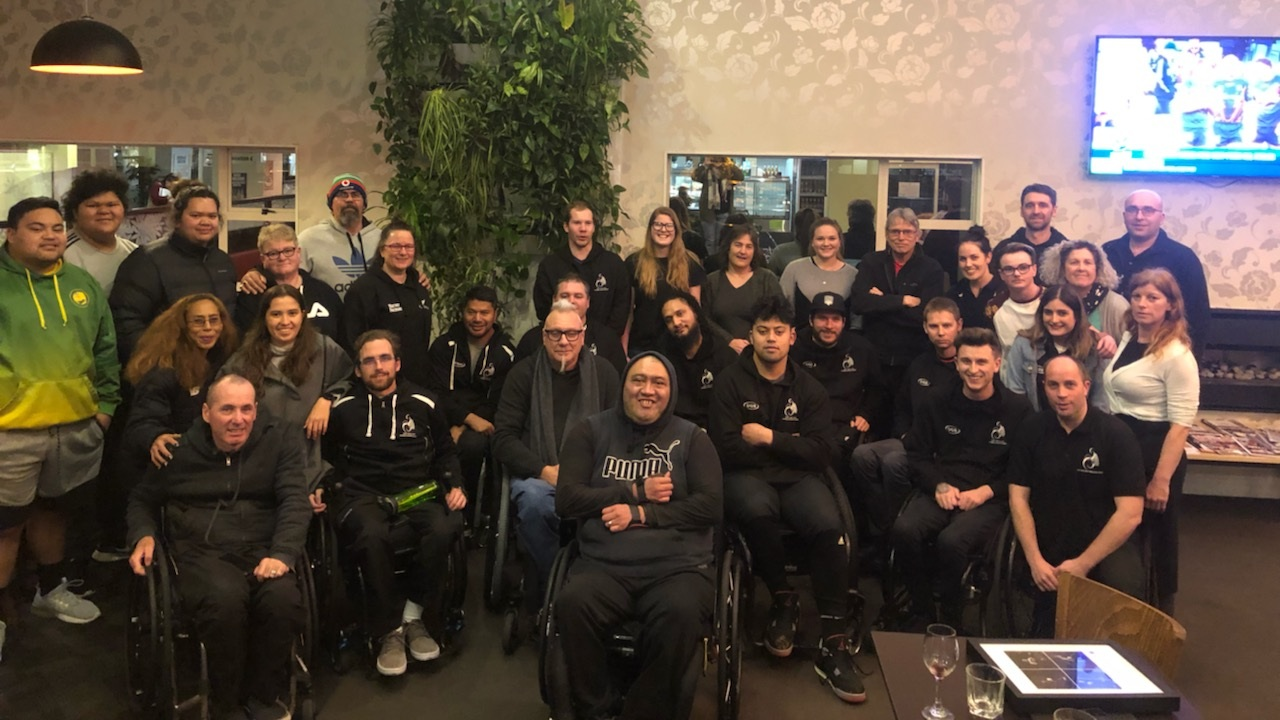 Wheel Blacks Team - Gareth Lynch, Nafi Lefono, Mike Todd, Tyler Jennings, Hayden Barton-Cootes, Gavin Rolton, Robbie Hewitt, Cody Everson & Cameron Leslie (not in photo), surrounded in support by the WB Team Staff, NZ Wheelchair Rugby Committee, Regional representatives and Volunteers.