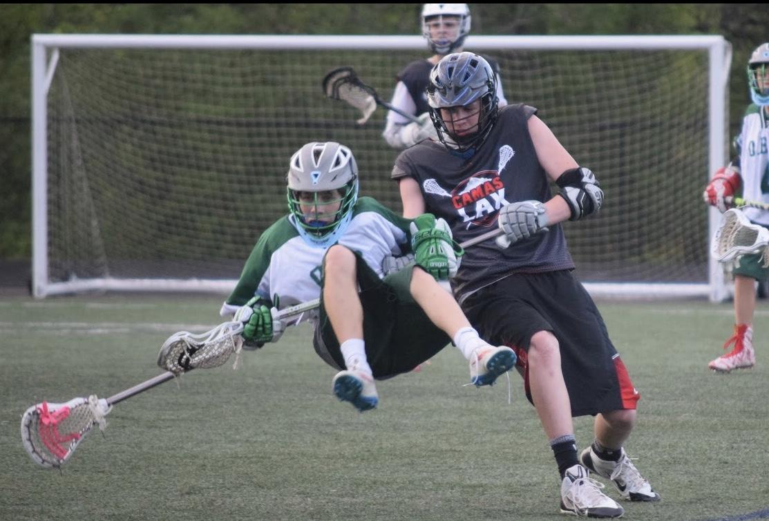 Jack dominates playing lacrosse.