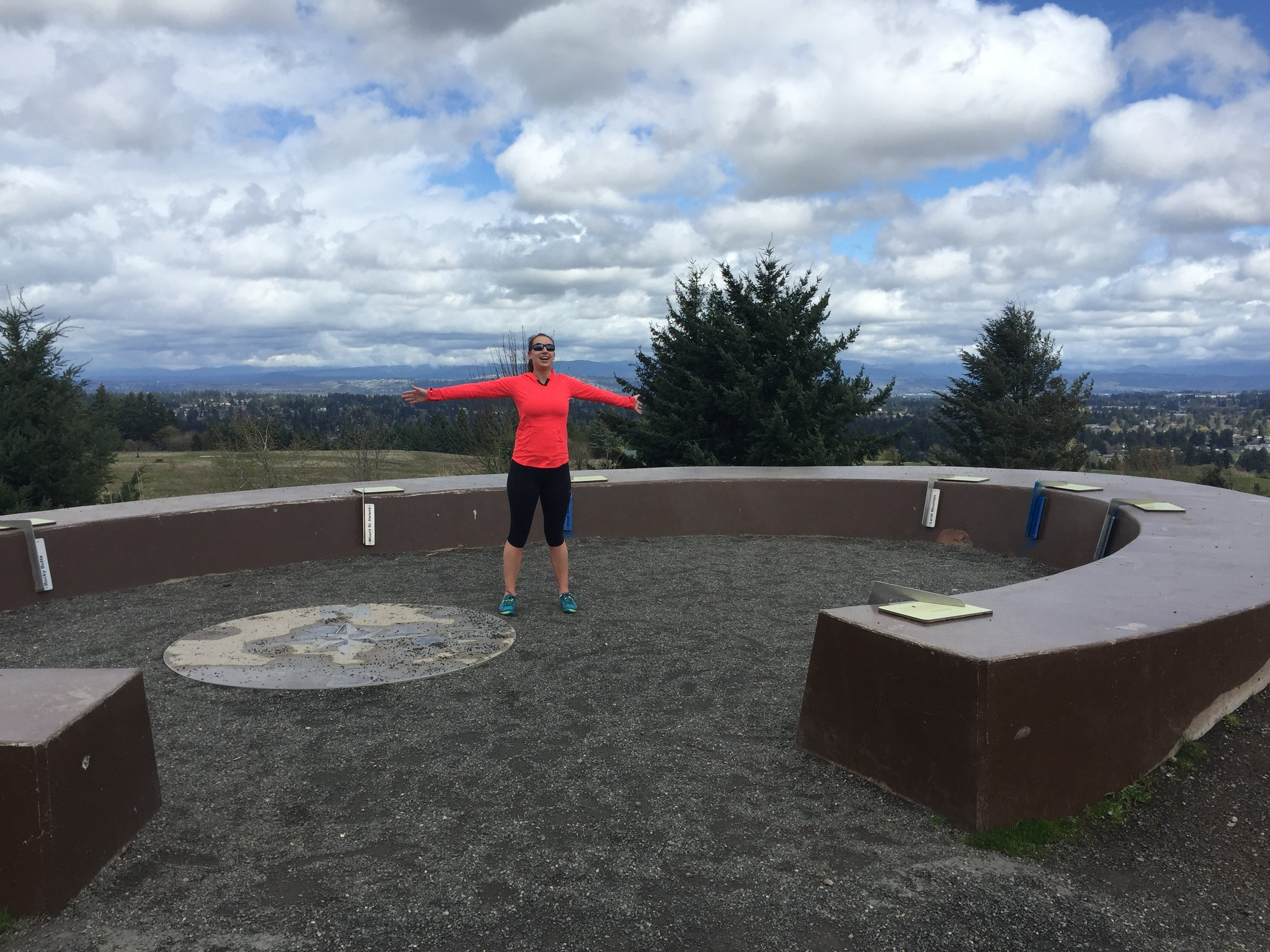 Standing in the middle of the the mountain finder circle at the summit of the volcano that is Powell Butte. On a clear day you can see up to 10 mountain peaks!