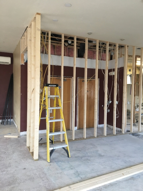 "Week Two - Framing in progress. This is the back wall of the Demonstration Kitchen...and the bathroom hallway is now 2"" wider!"