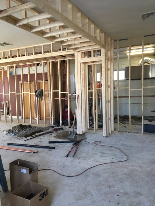 Week Three - Framing continues with soffit and closet construction. You can see that we're starting to shape and define spaces. Check out those pipe cutters on the floor in the foreground. They provide enough leverage for one guy to cut through the heavy duty metal pipes nearby!