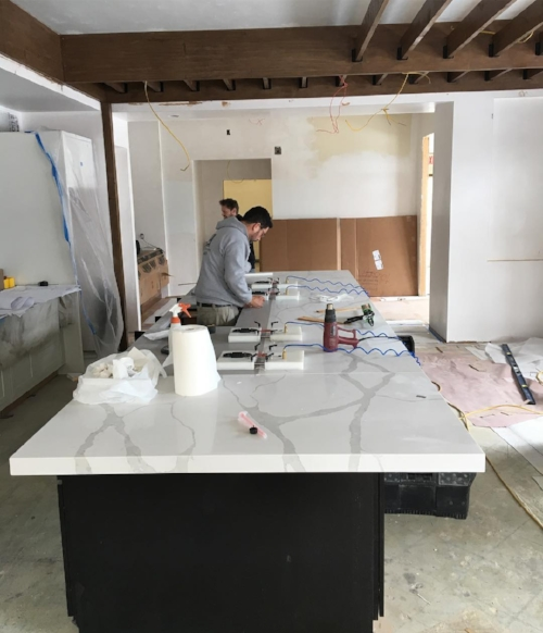 Island counter top installation in the demonstration kitchen.