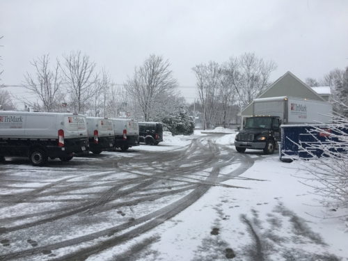 The fleet of Trimark trucks outside of Orange Door Kitchen on a snowy March morning the day of our commercial kitchen equipment delivery and installation.