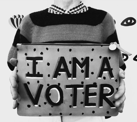 VOTE - Purchase any clutch from @shopclarev and they can hand paint #iamavoter for you. Text VOTER to 26797 to make your plan to vote.