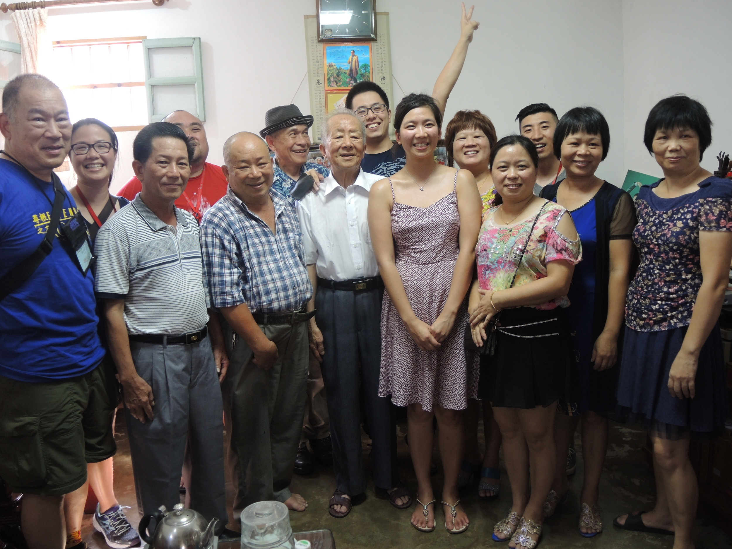 Family group photo with leaders inside third granduncle's home after some kung fu cha