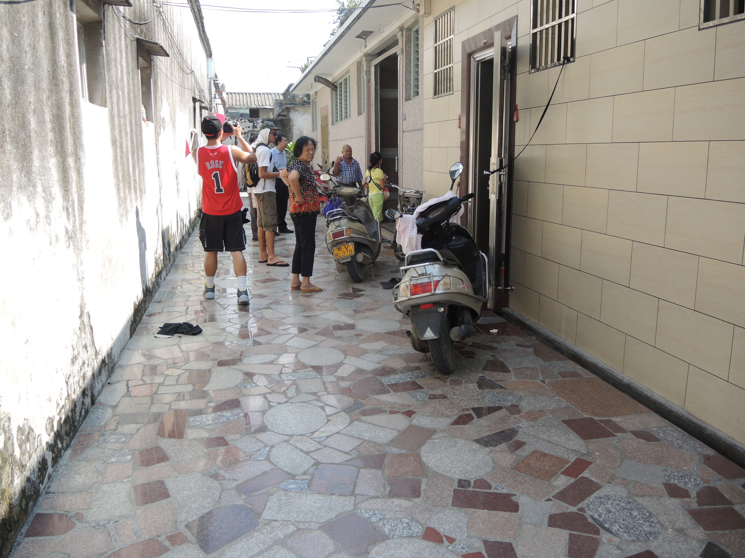 My three granduncles live next door to each other. They paved their pathway/alley with marble stone.