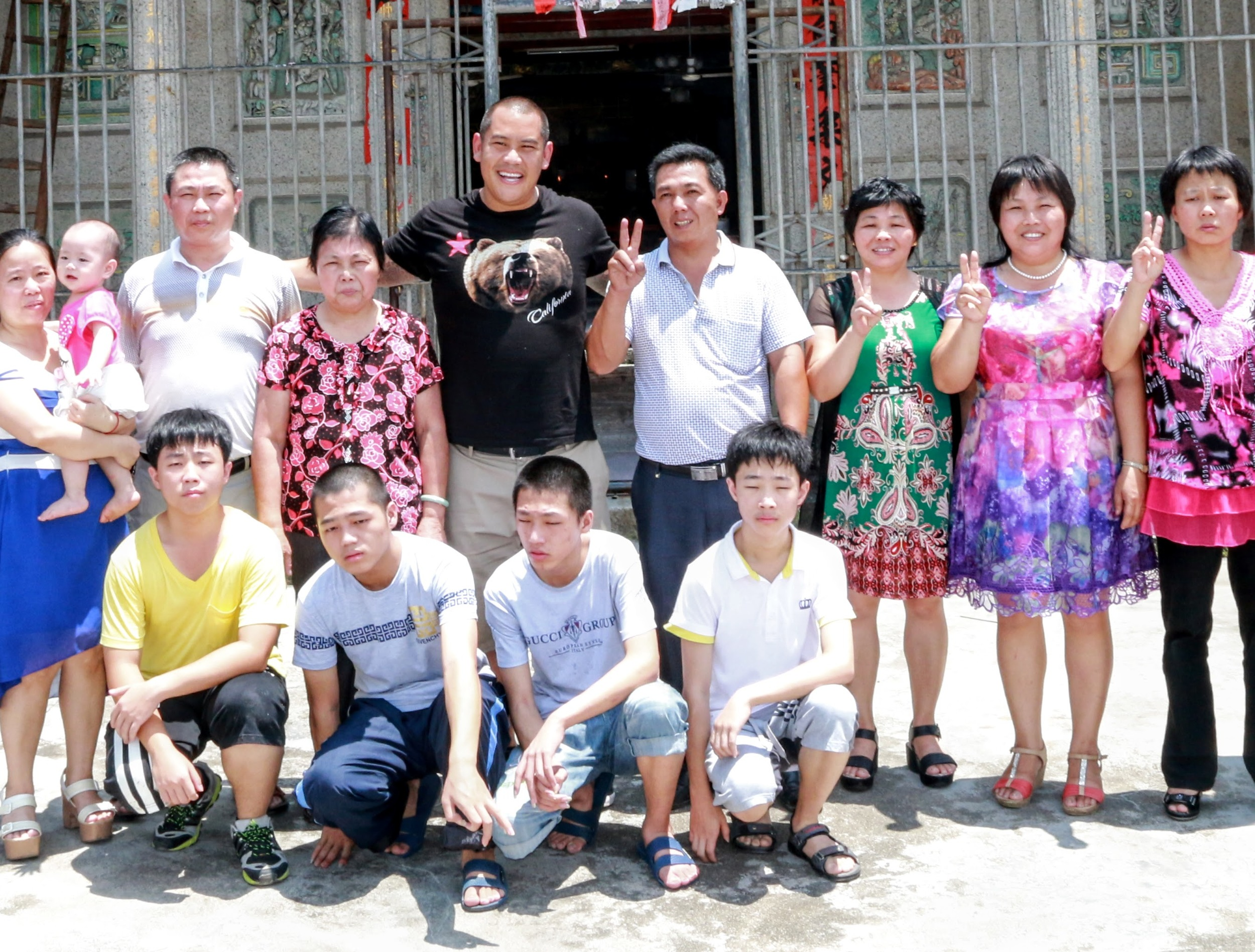 family photo outside the village temple