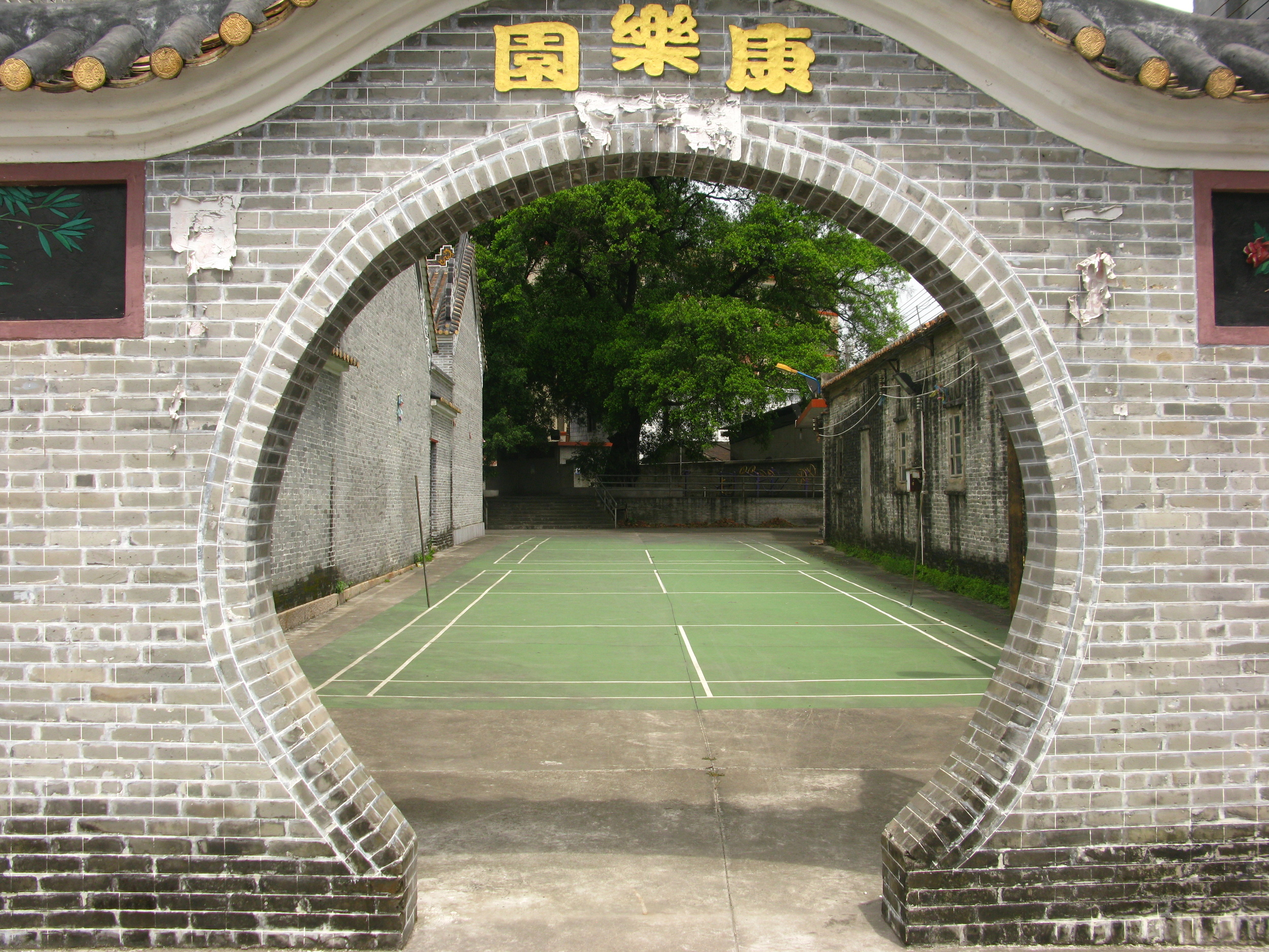 Outside are badminton courts and playground space