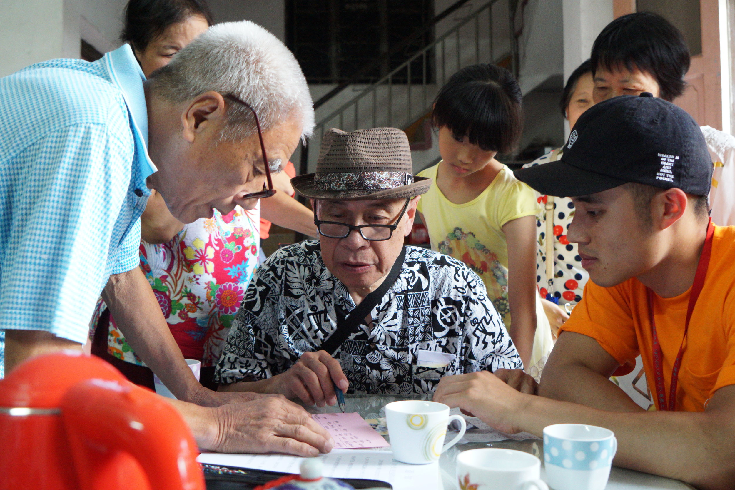 Looking at genealogy books in Scott Leung's paternal grandfather's village in Shunde