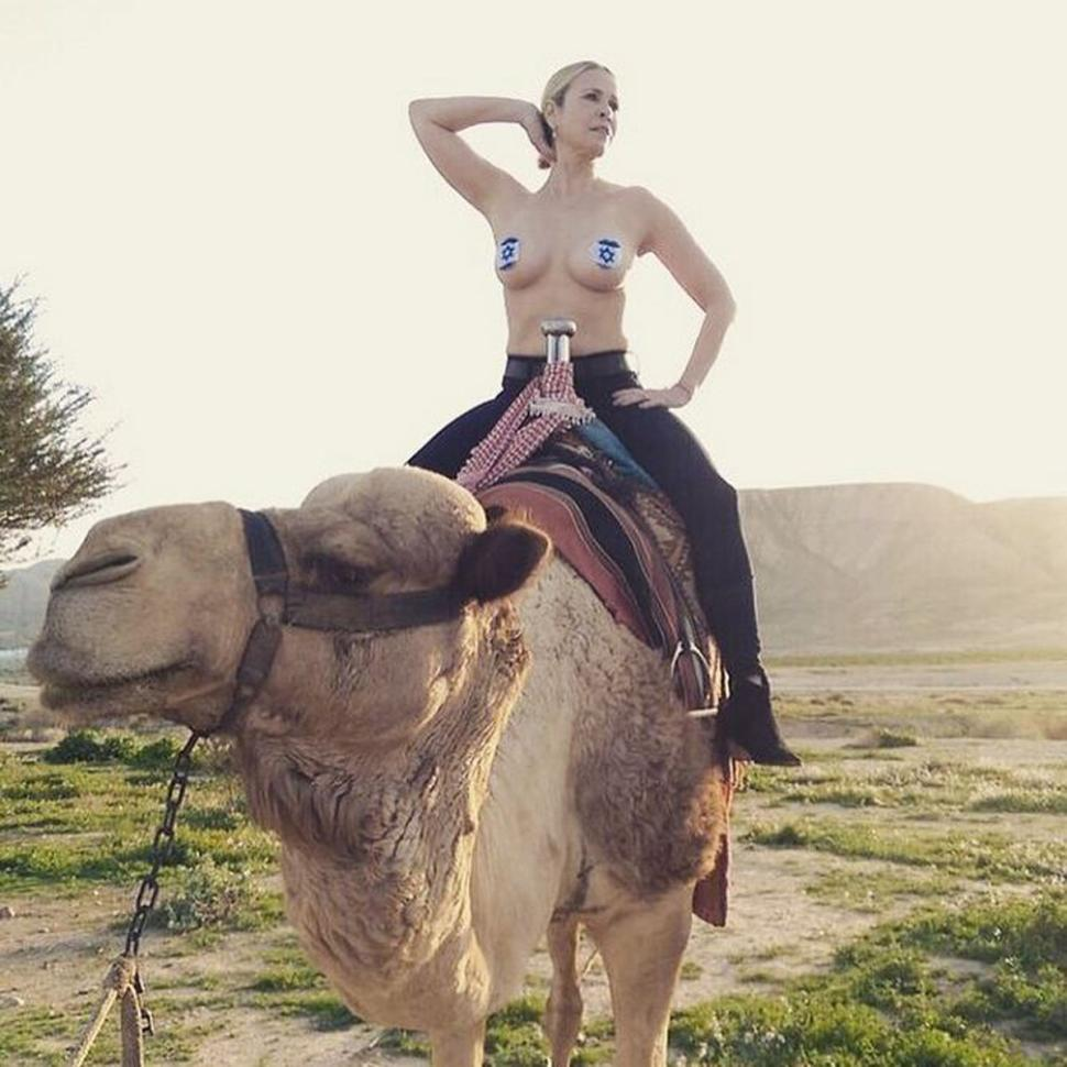 """""""A Muslim allowed a topless Jew to sit on his camel"""" Handler says as she makes a bold statement for peace in the Middle East."""