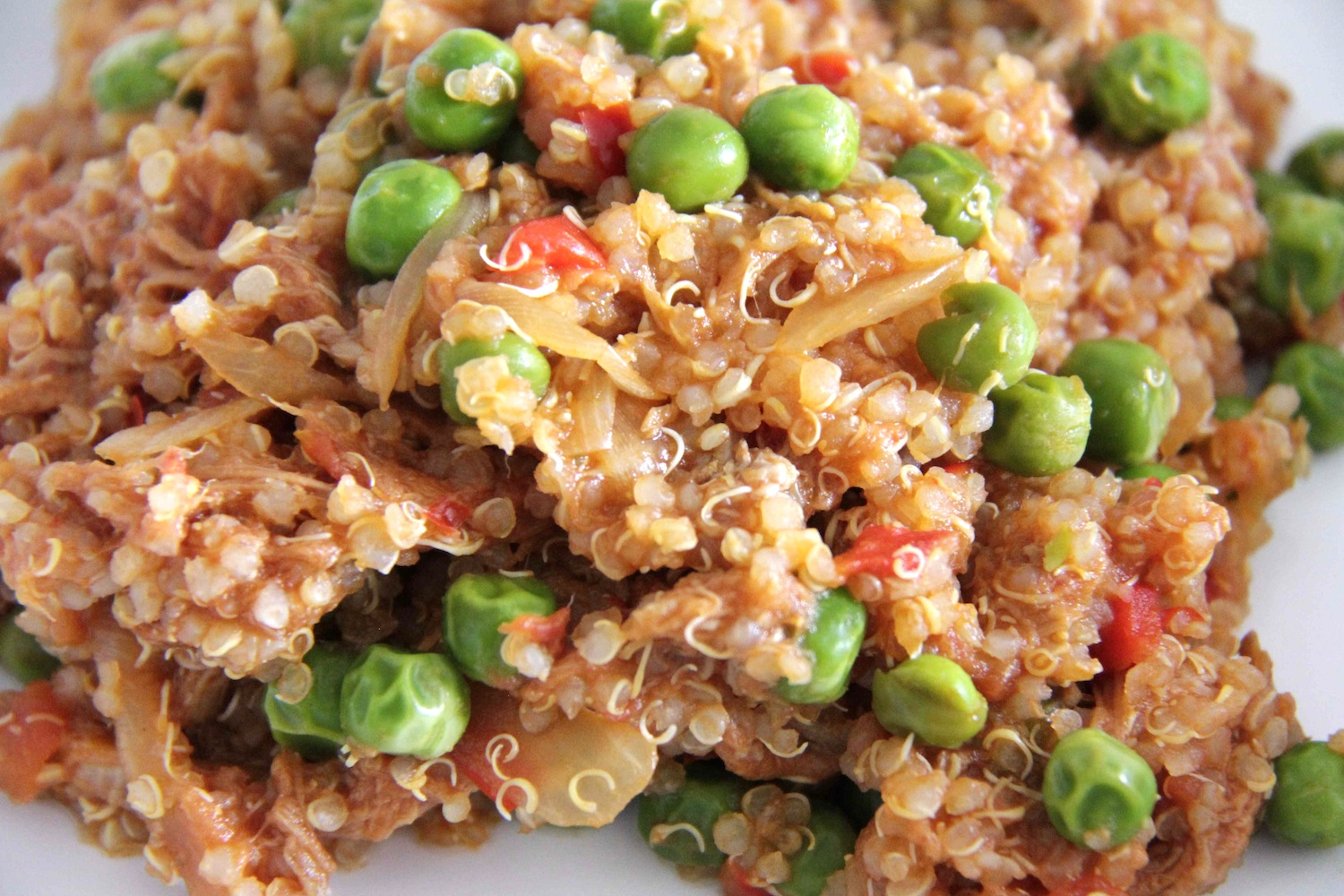 Pork ragu with quinoa, peas and red capsicum