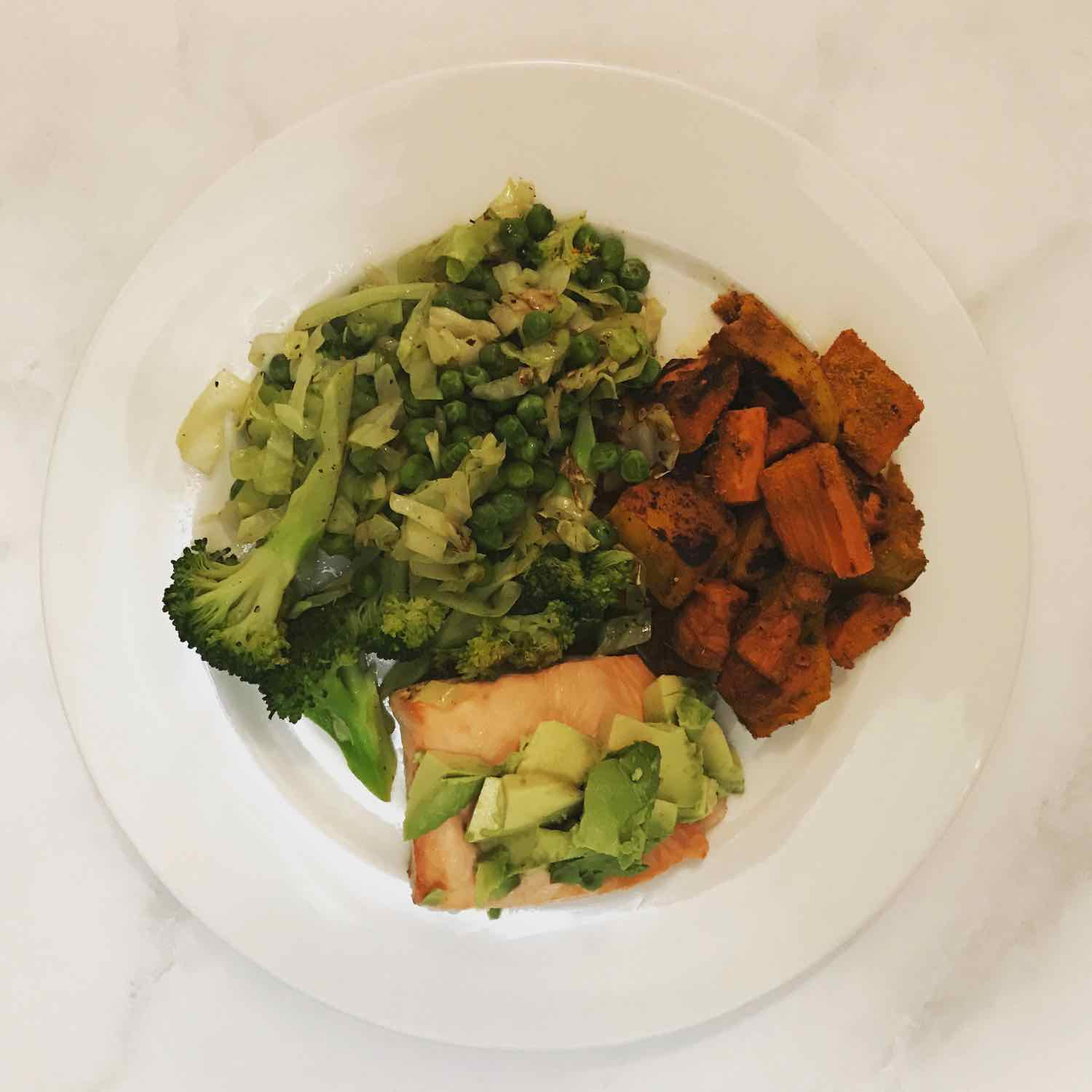 Steamed greens, Roasted vegetables & salmon topped with Avocado