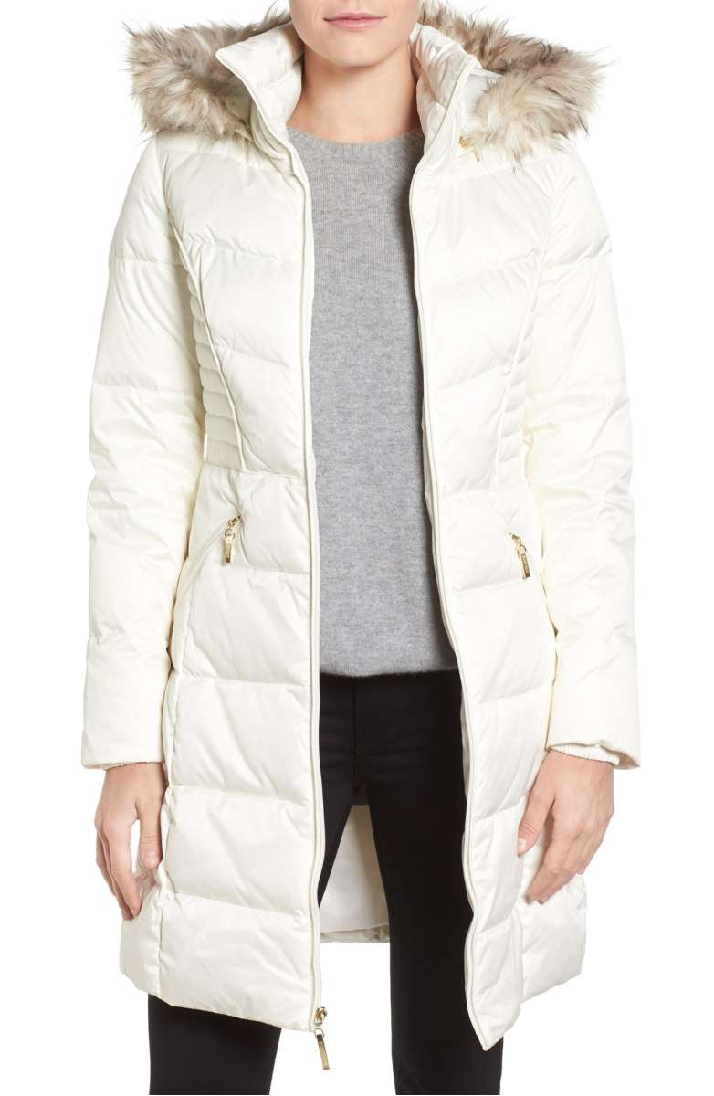 white hooded fur coat
