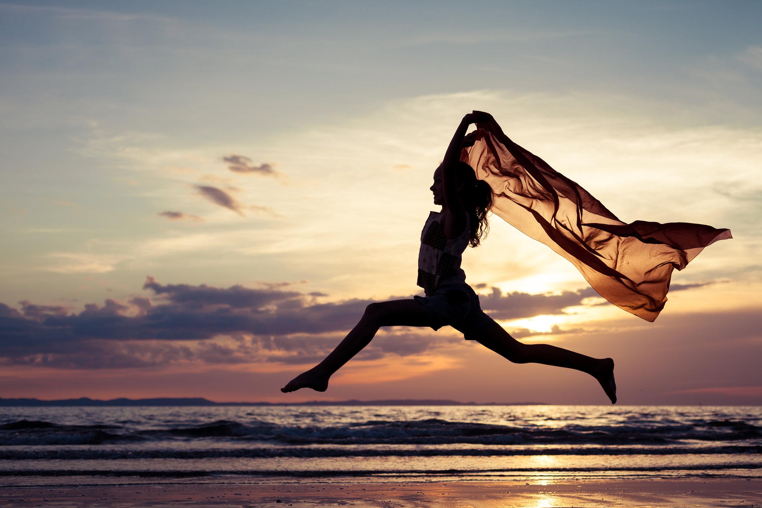 Girl Jumping Ocean.jpg