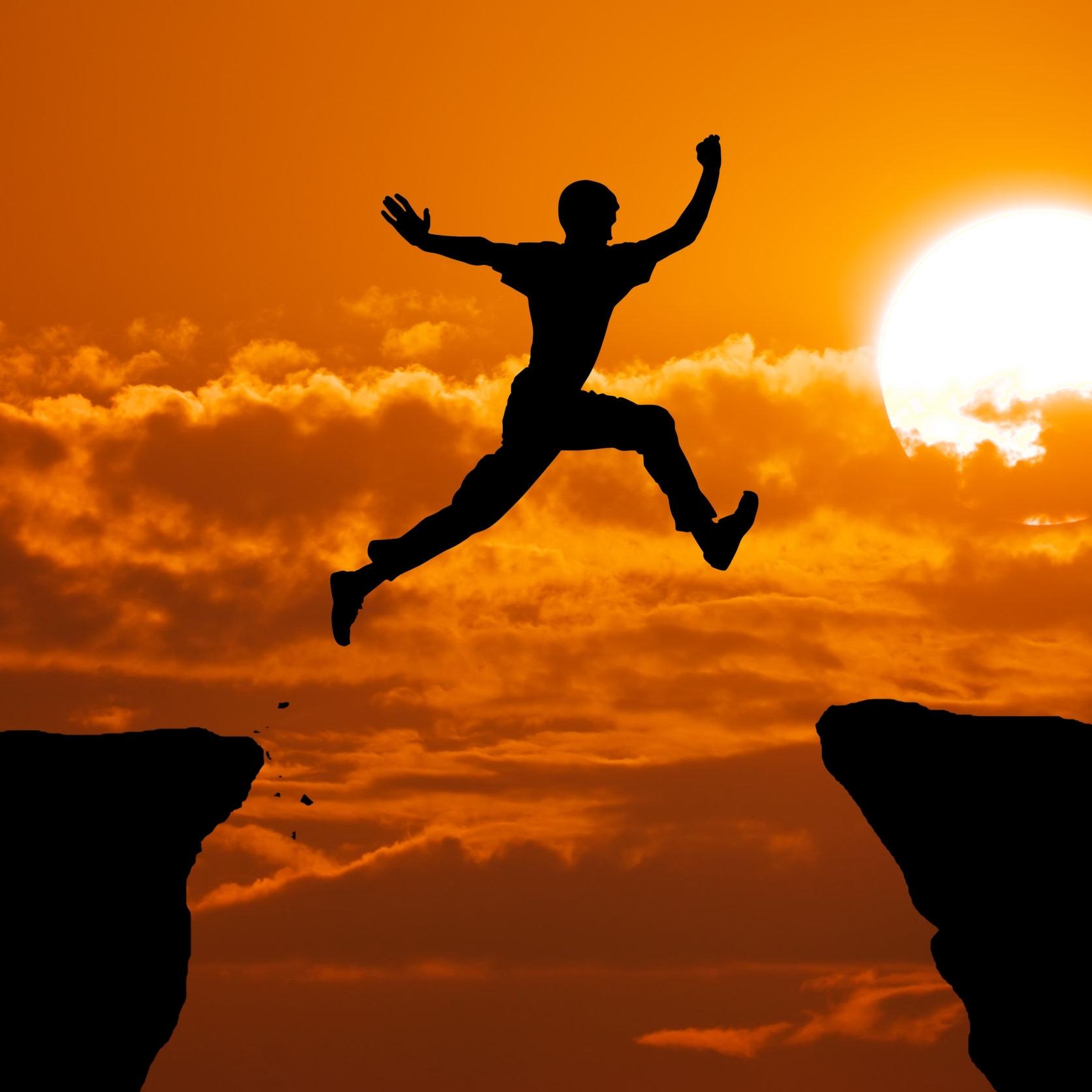 Man jump on gap orange sun.jpg