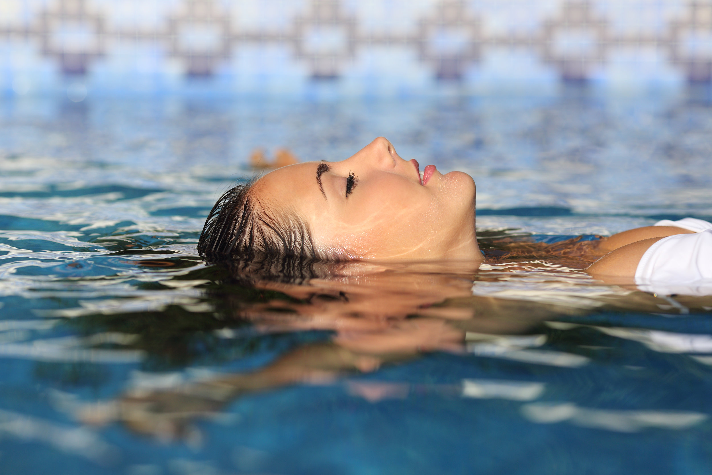 Profile of a beauty relaxed woman face floating in water.jpg