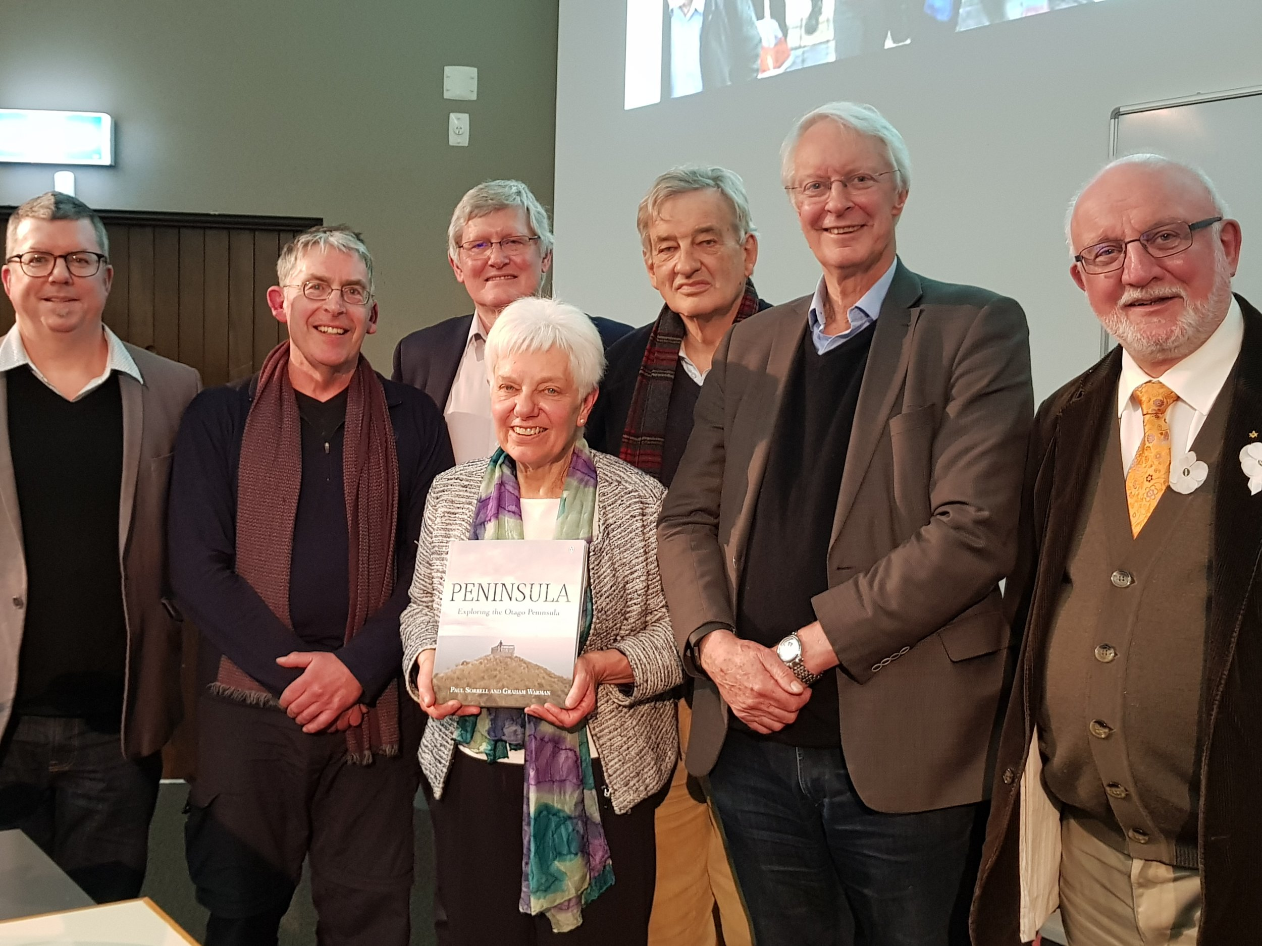 Members of the Archibald Baxter Memorial Trust with Maire Leadbeater. From left: Richard Jackson, Paul Sorrell, Tony Eyre, David Grant, Kevin Clements, Alan Jackson.