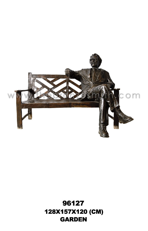 Bronze garden bench with a man