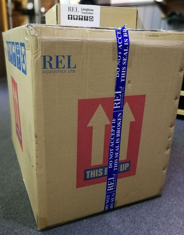 A very big box contains the REL 212SE