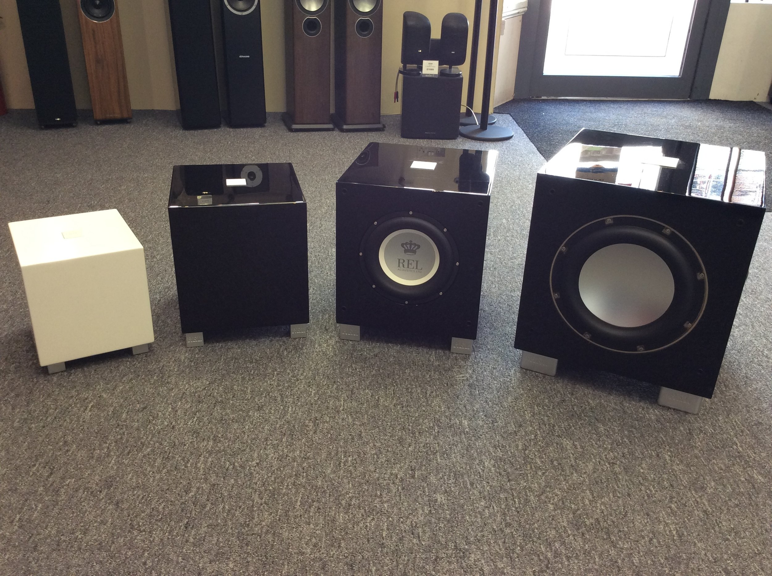 REL subwoofers come in different sizes and most are available in a piano white or piano black.