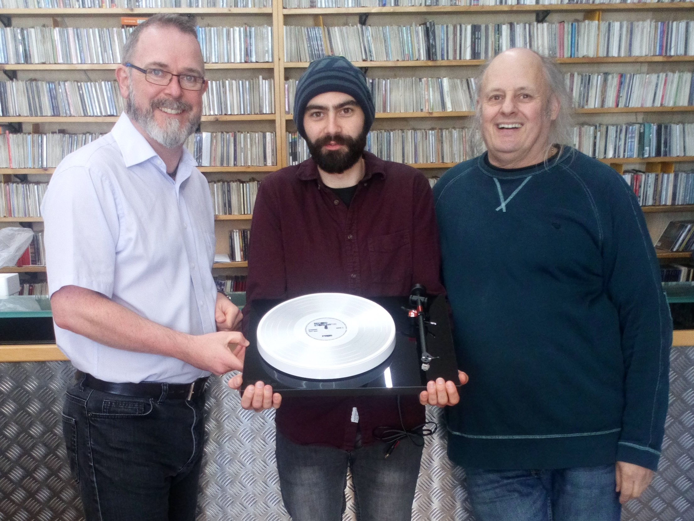 Nic Forbes on the left, our lucky winner David Mayes and Christos on the right.