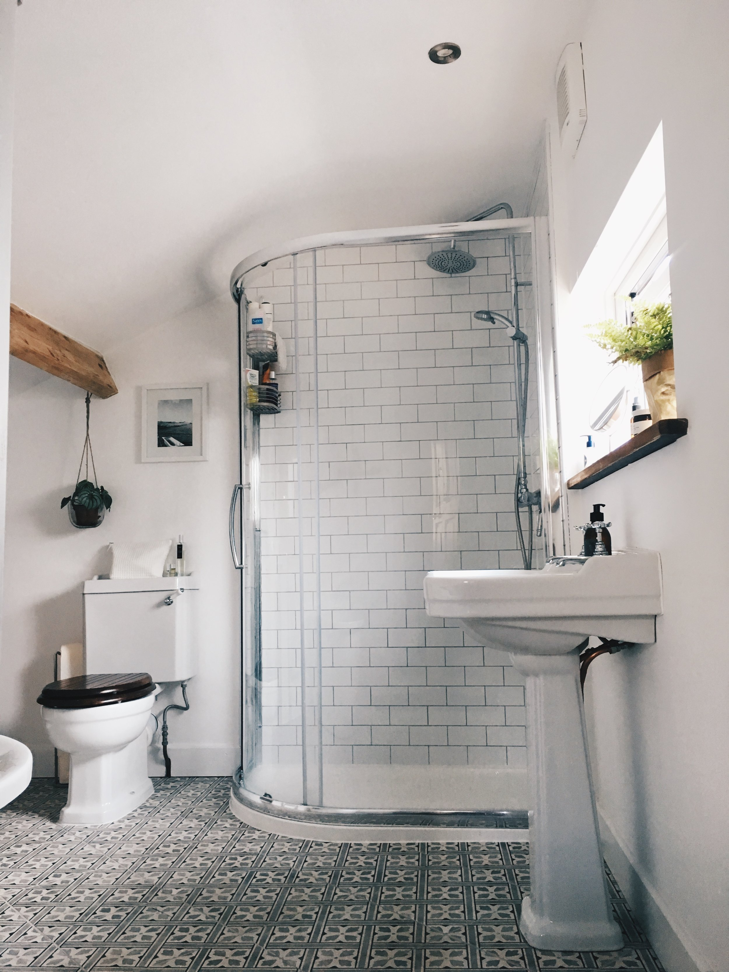 Choosing a clear and curved cubicle has made the bathroom feel more spacious and brighter.  We also had a smaller window fitted so that the sink could sit under it.  The window was double the size before and also offered no privacy.