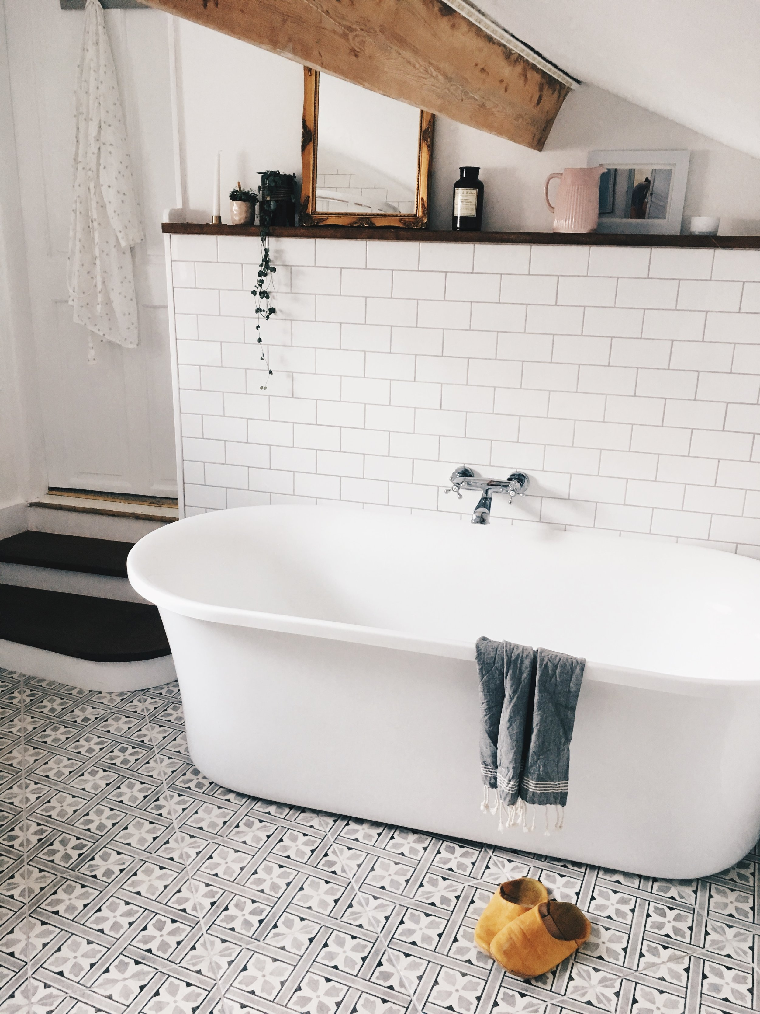 We all love the bath we chose - a modern take on the roll top.  It was from Victoria Plumb online and fits the space perfectly.  Having the bath here is much more comfortable and having the taps mounted on the wall in the middle mean that you can face the room.