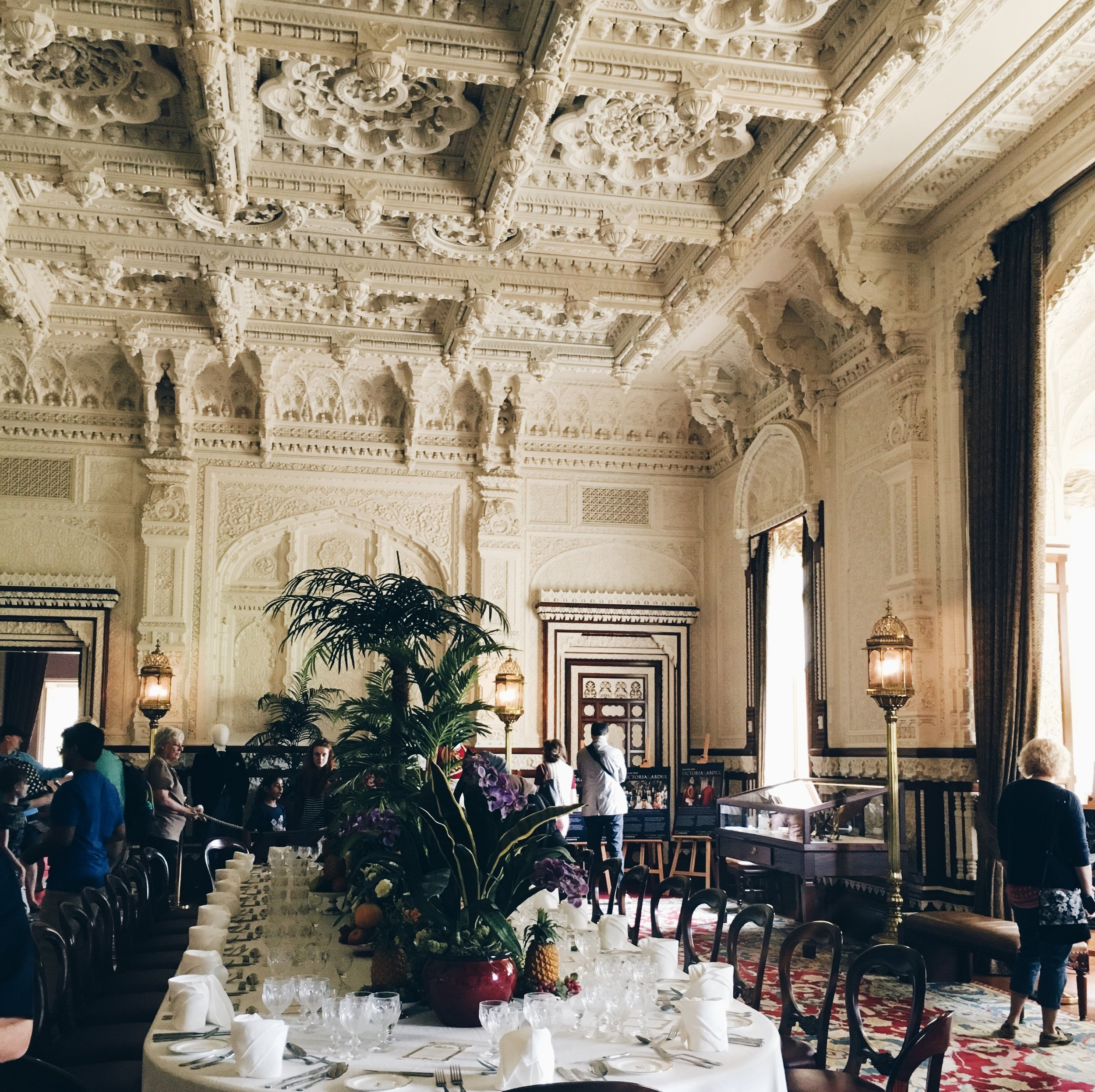 This is the Durba Room which was inspired by Victoria's love of India.  Osborne House has been used to film the recent film Victoria and Abdul because the house reflects her love for this part of her empire. The ceiling is really breathtaking.  The table setting is an example of how the table would have looked for formal dinner parties.  As you walk through the kitchen you can view the chef's log of the meals they cooked for the Queen. Lets say it's no wonder she had to have rather large dresses made!