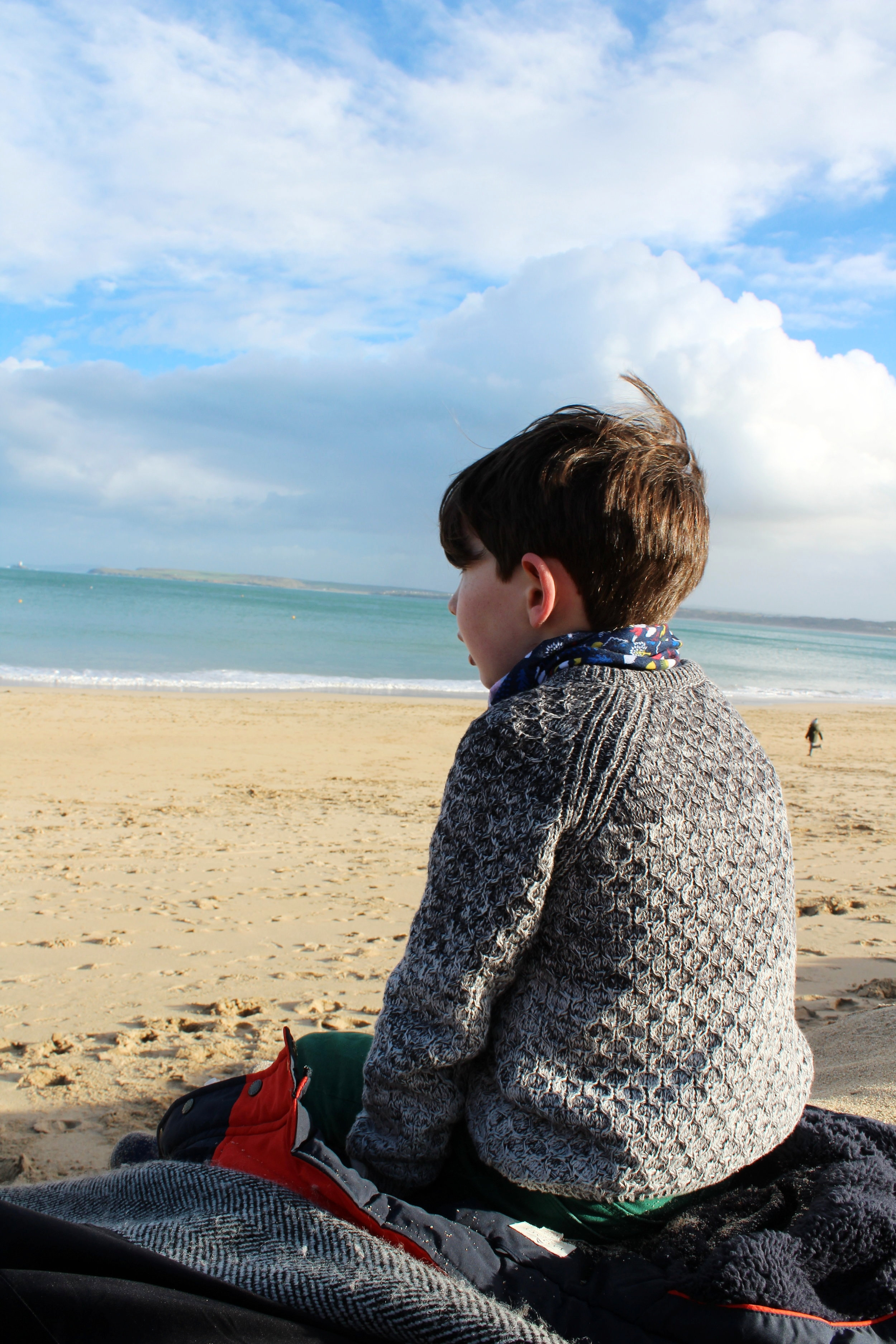 Sitting on the beach wrapped up on a sunny Winter's day equals any Summer one. This was taken on Porthminster beach. This beach has calmer waves and doesn't get deep too quickly. On low tide you can walk across the sand straight to the town of St Ives.
