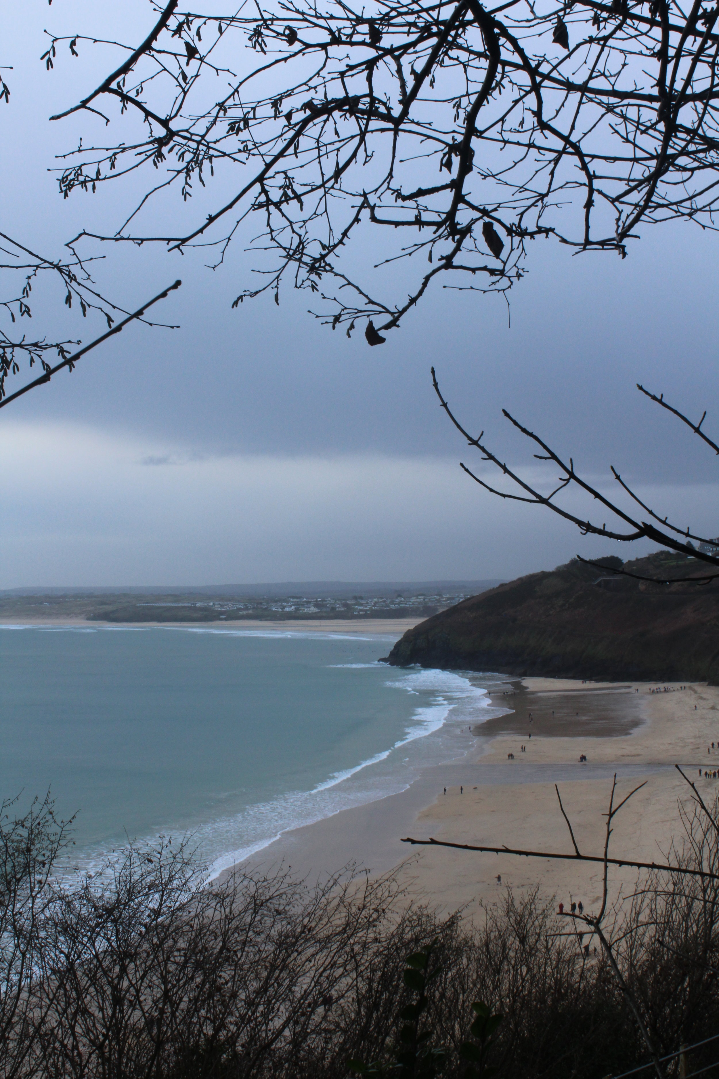 Even on a rainy day the light is beautiful. It always has a grey/ blue tint to it. This is the view of Carbis Bay beach from the walk into St Ives. This is a lovely twenty minute walk that takes under the railway and by some beautiful houses. It brings you out onto Porthminster beach where you could go for lunch at the wonderful Porthminster Café or grab a hot chocolate from one of the kiosks on the beach and drink it over looking the pale turquoise sea.