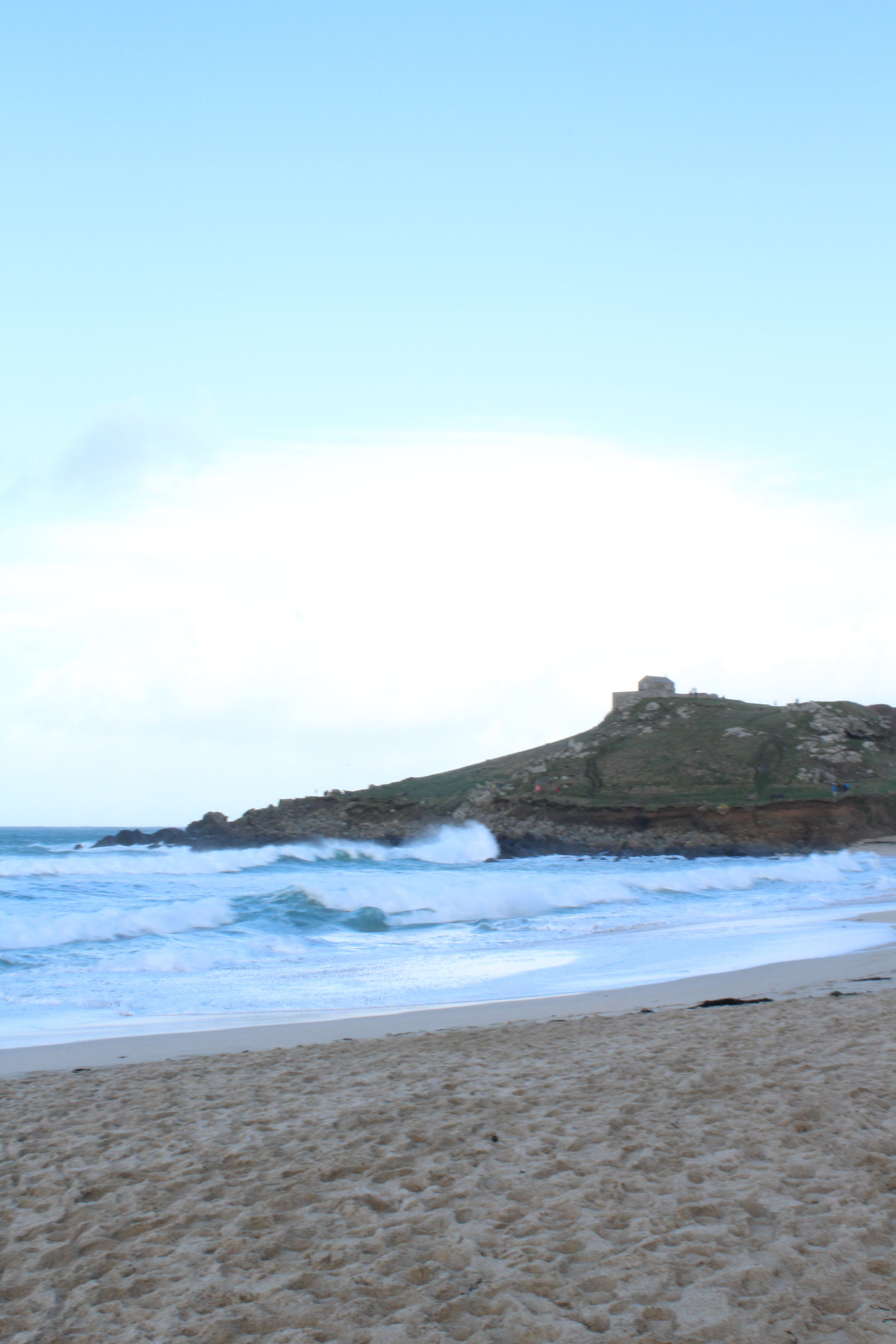 The crashing waves of Porthmeor and the Island of St Ives. This is the main beach for surfing in St Ives and there were quite a few out on this fresh New Year's Eve. This is the beach that The Tate overlooks and also has it's own fabulous café that sell tapas meals as well as mains. There are outdoor booths with heaters and blankets are provided. In the summer the West Beach bakery sells amazing freshly baked pizzas and is a little quieter than some of the main restaurants in the centre of town.