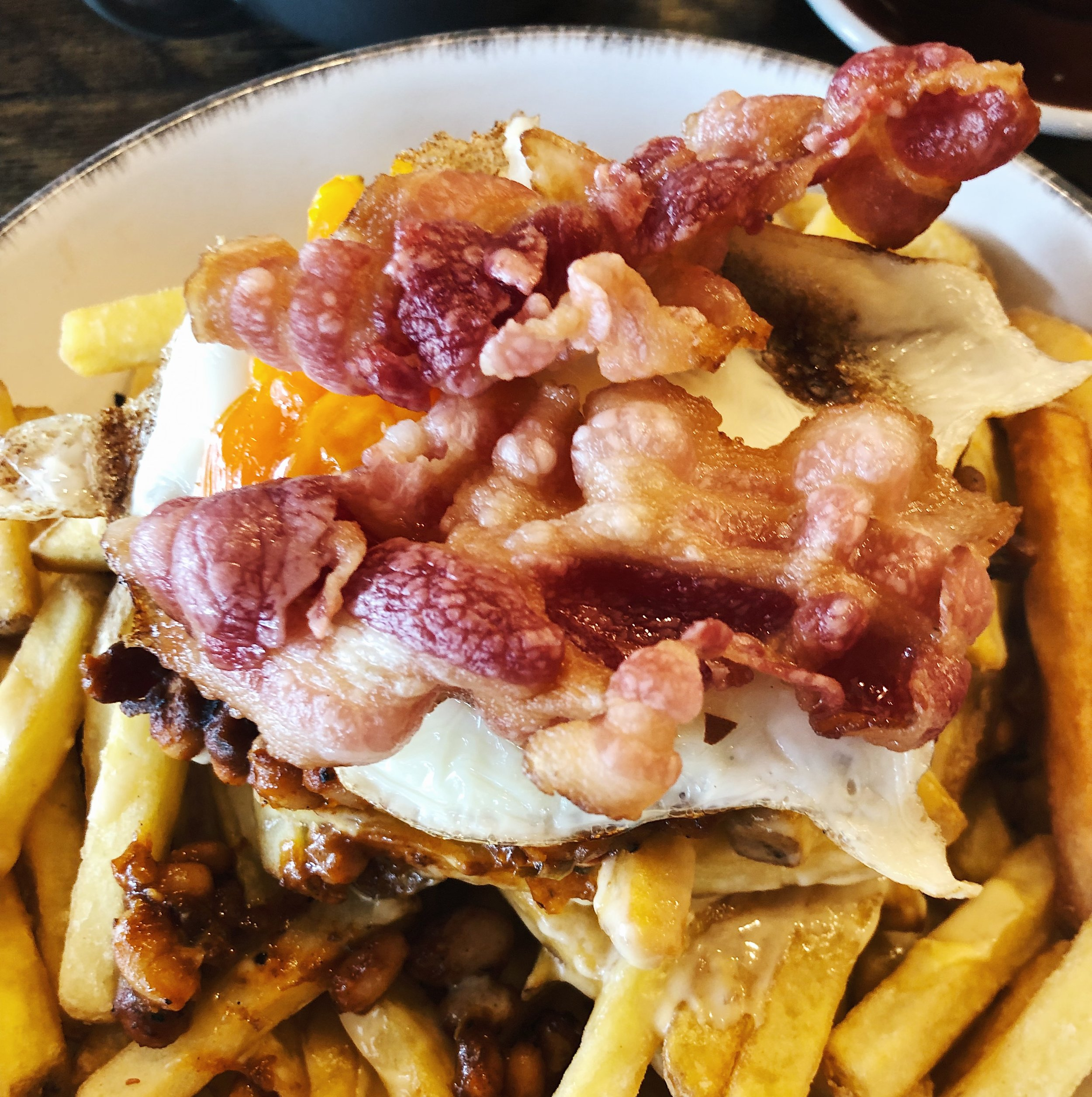 This breakfast was so good!! Smoky barbecue beans and cheese sauce on fried potatoes topped with fried egg and bacon. It was huge and my husband had to help me finish it (doesn't often happen). Very filling for a rainy morning.