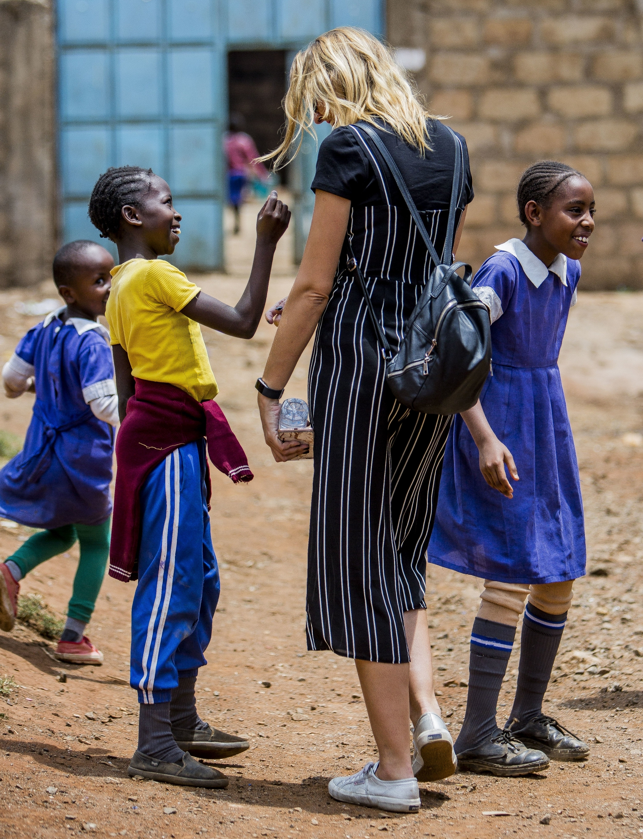 Leanne laughs with children in Mathare.