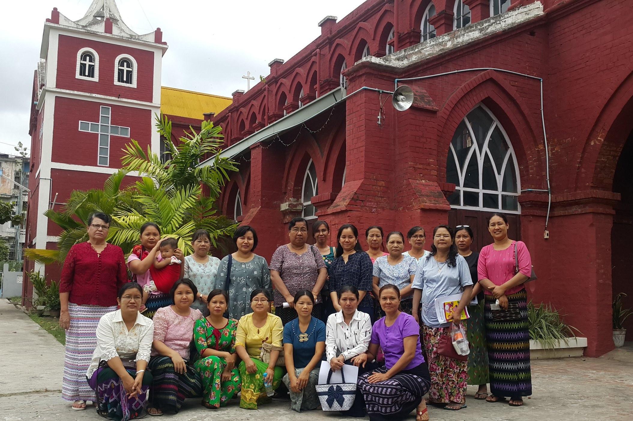 Members gather outside their church for business training.