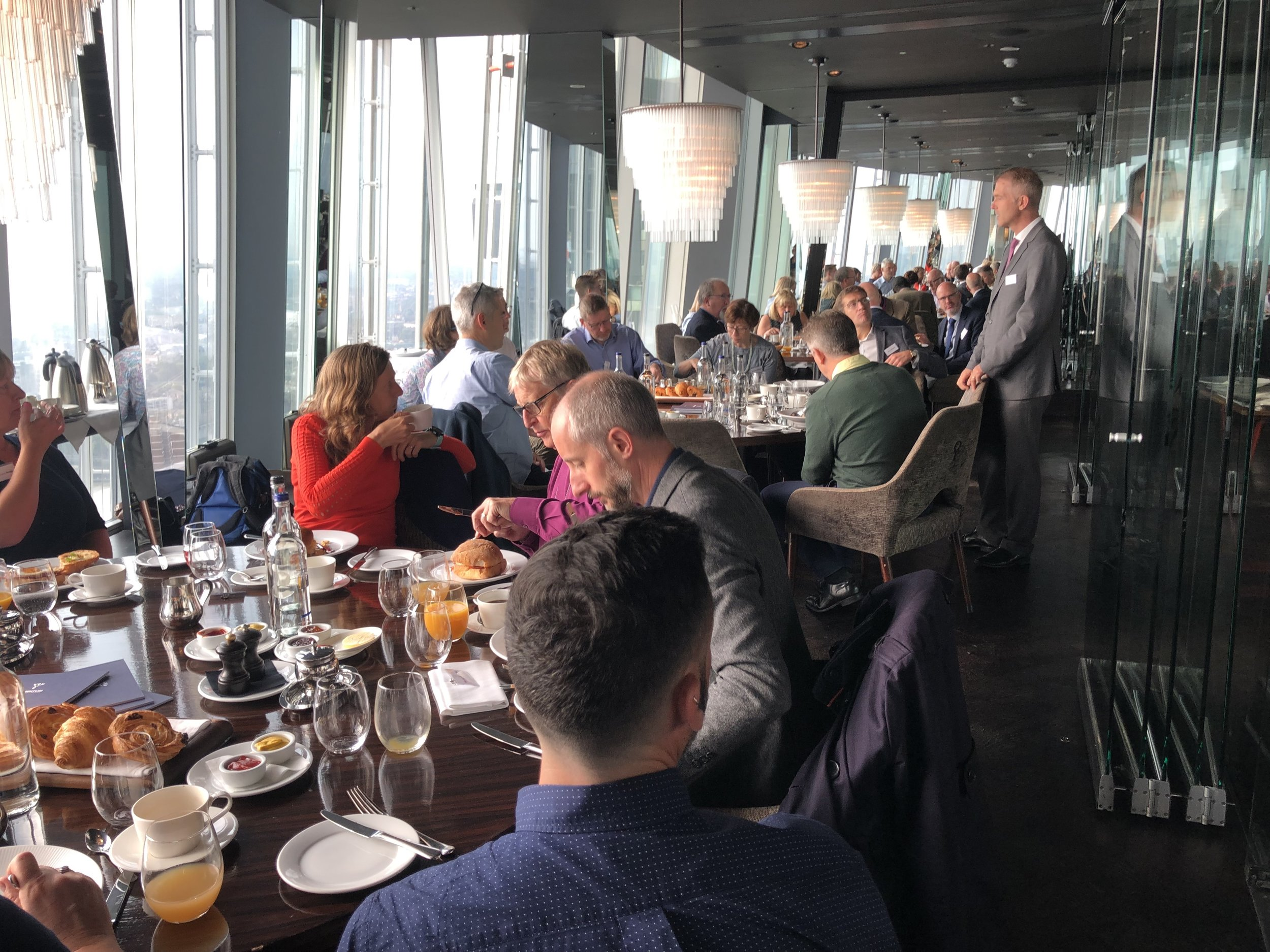 Tom speaks at the Shard for Five Talents supporters.