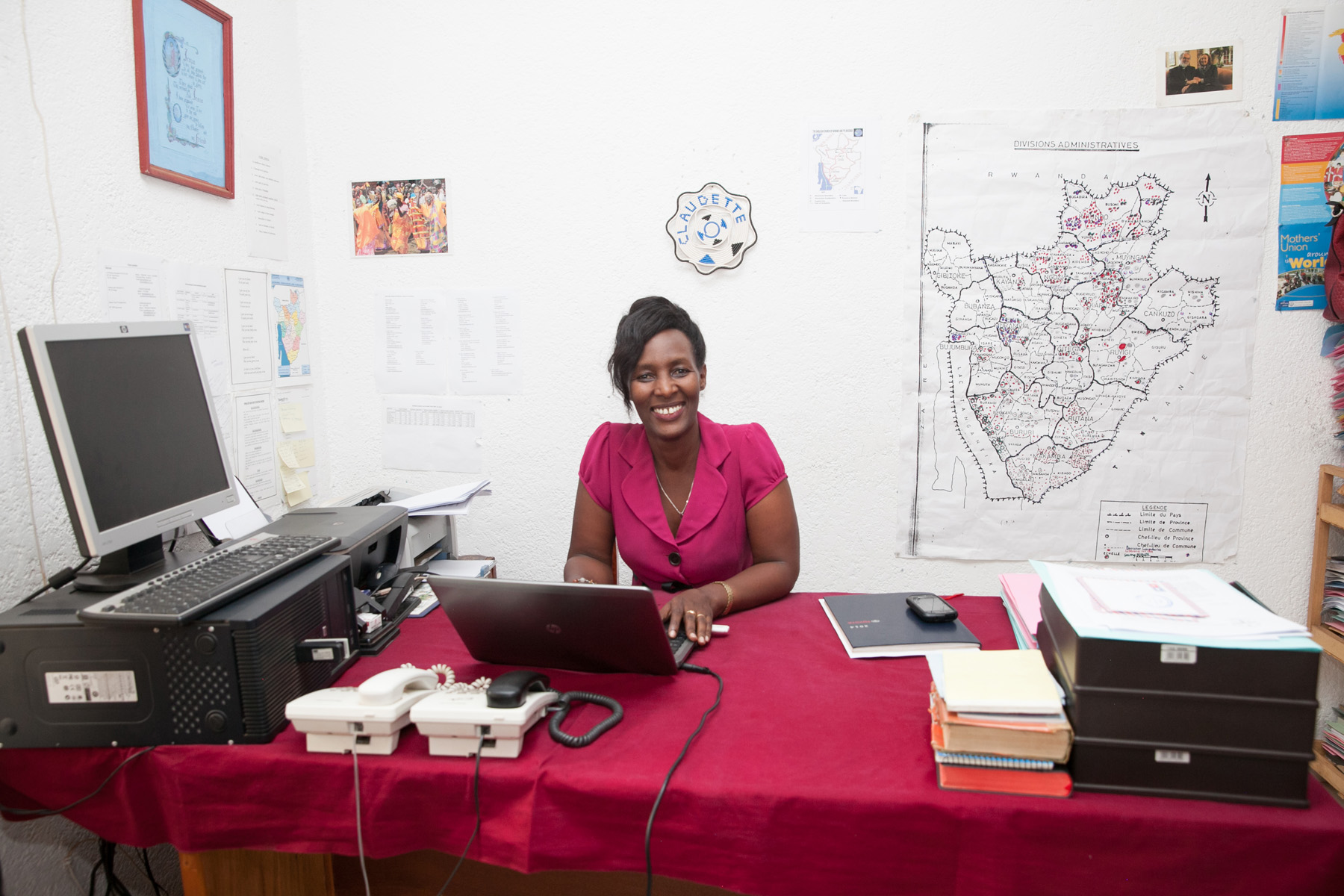 Claudette at her desk. Photo by  Ross Oscar Knight .