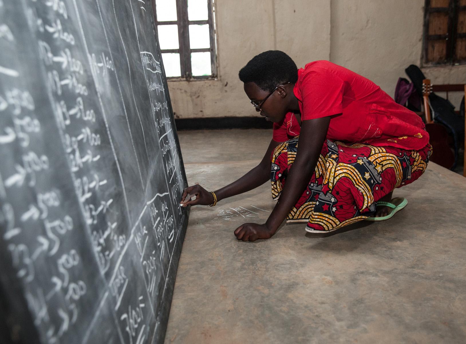 Literacy group learner in Burundi. Photo by  Ross Oscar Knight .