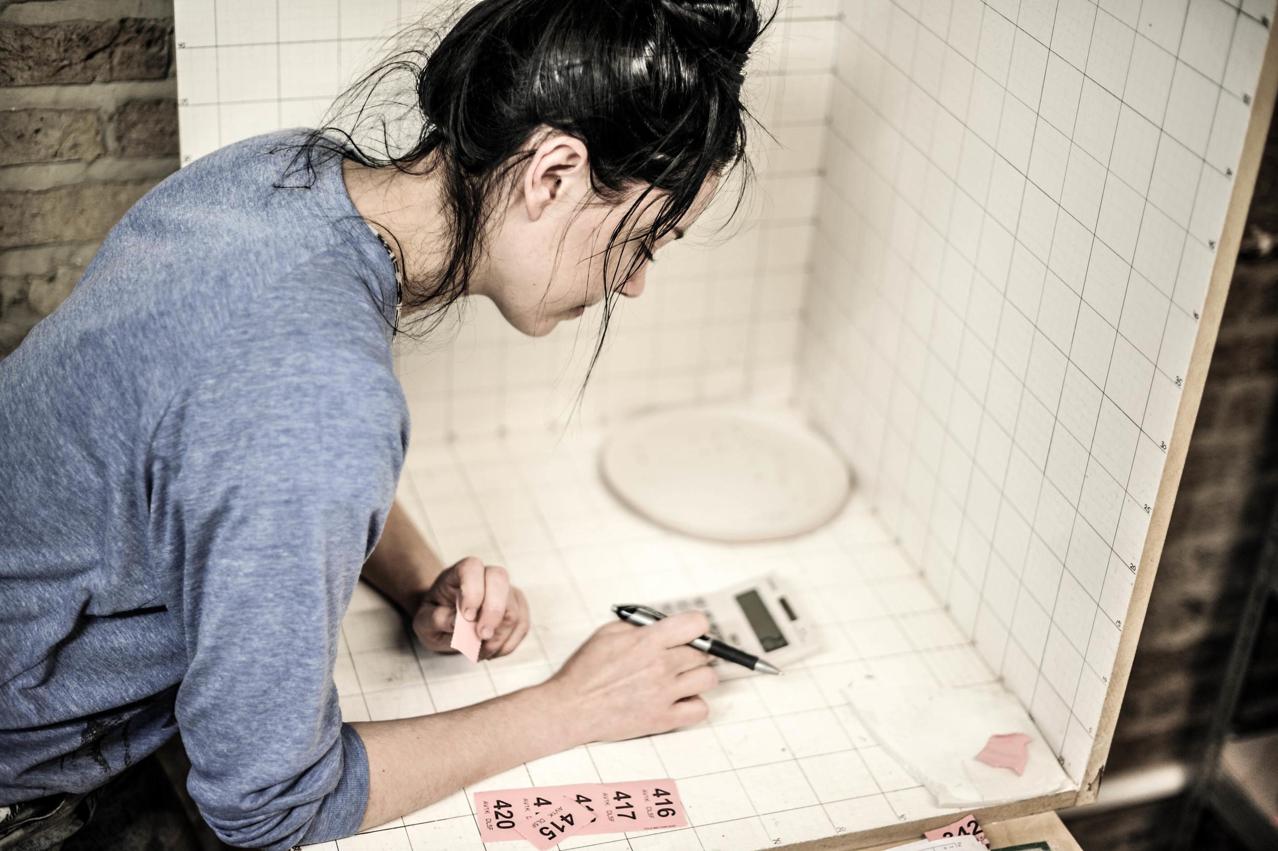 Lisa measuring her glazeware