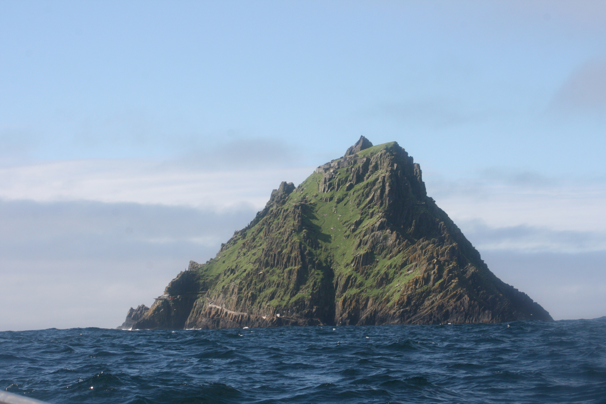 Approaching Skellig Michael by boat. Skellig Michael is a UNESCO World Heritage Site and the 12th century monastic settlement and views continue to inspire and inform Donagh Carey's paintings.