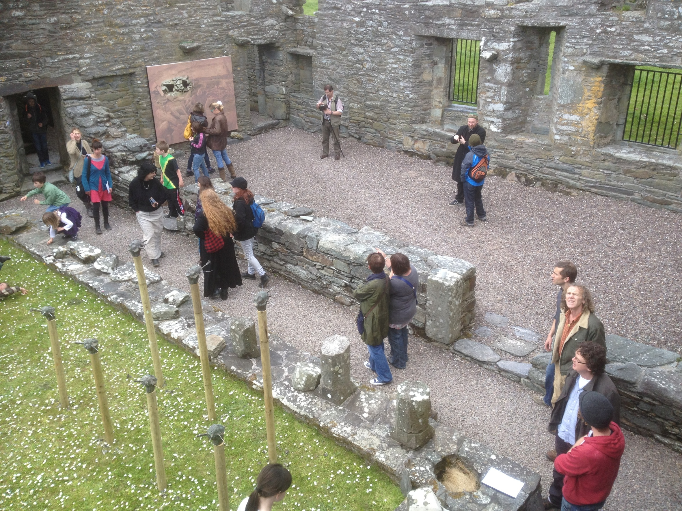 Visitors to Sherkin Abbey on Sherkin Island in West Cork viewing the 'Entrophy & Relic' exhibition.
