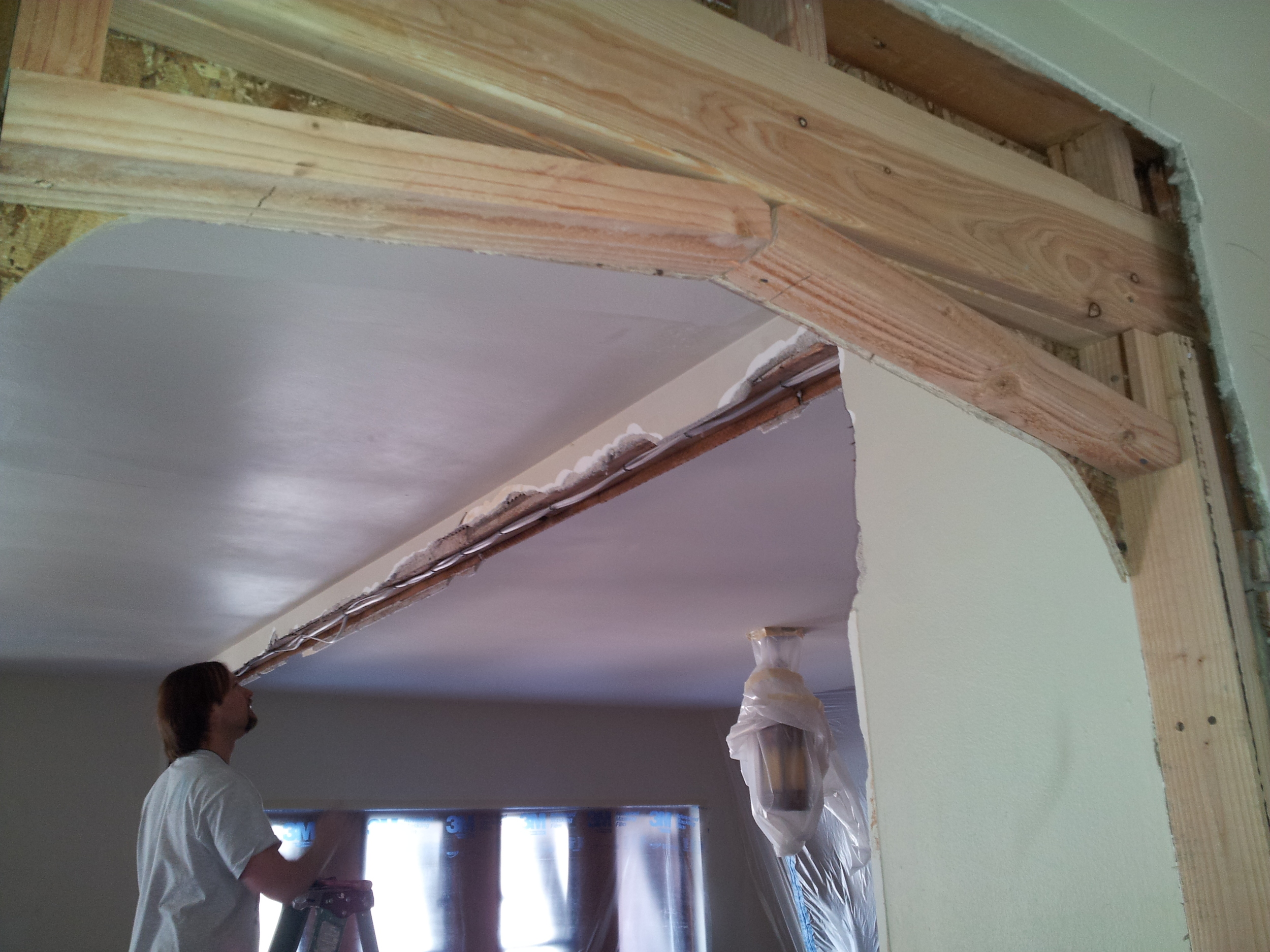 Removing interior walls and architectural framing period appropriate tudor arches