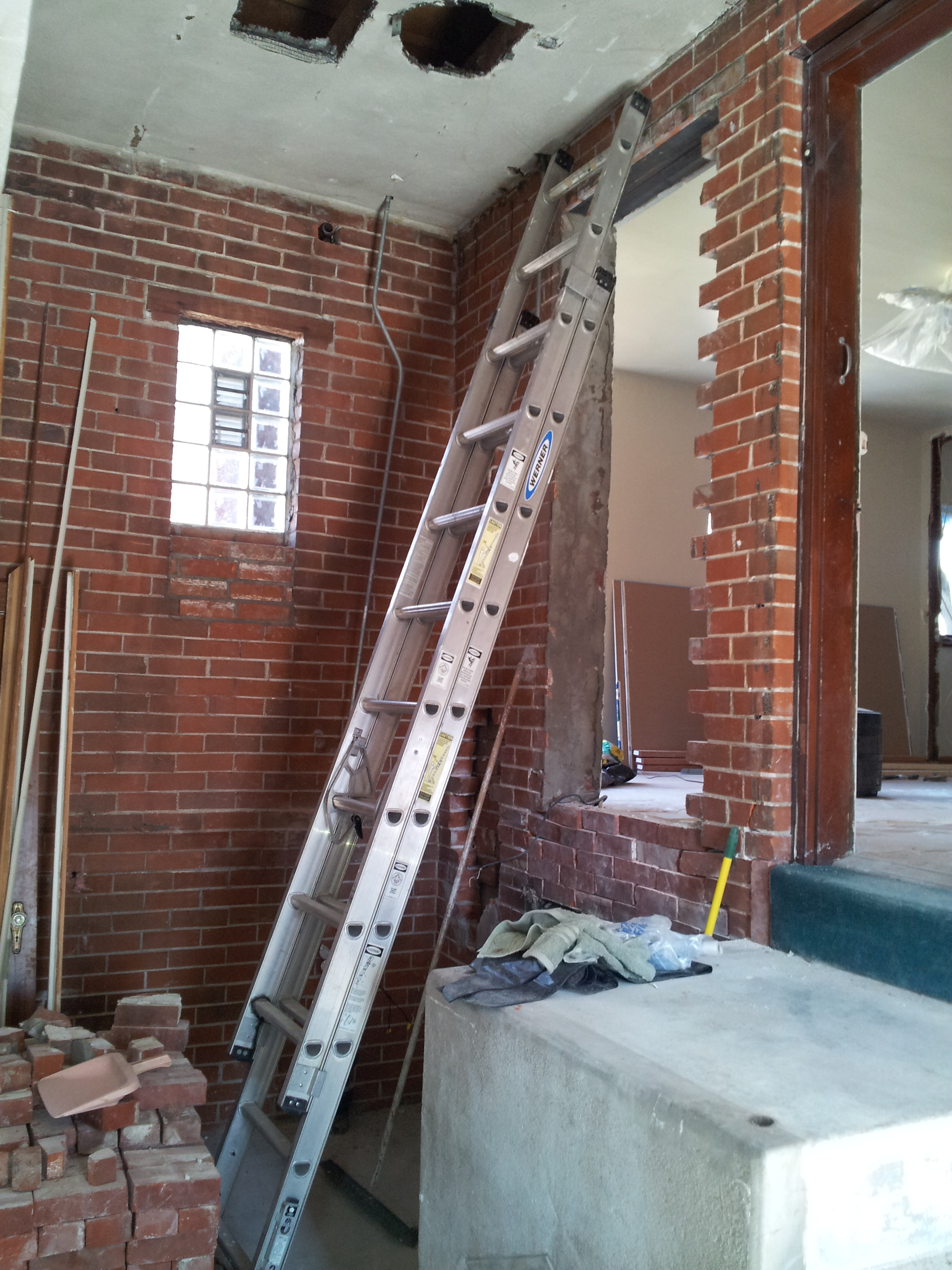 Existing entry door being relocated and filled in brick exterior