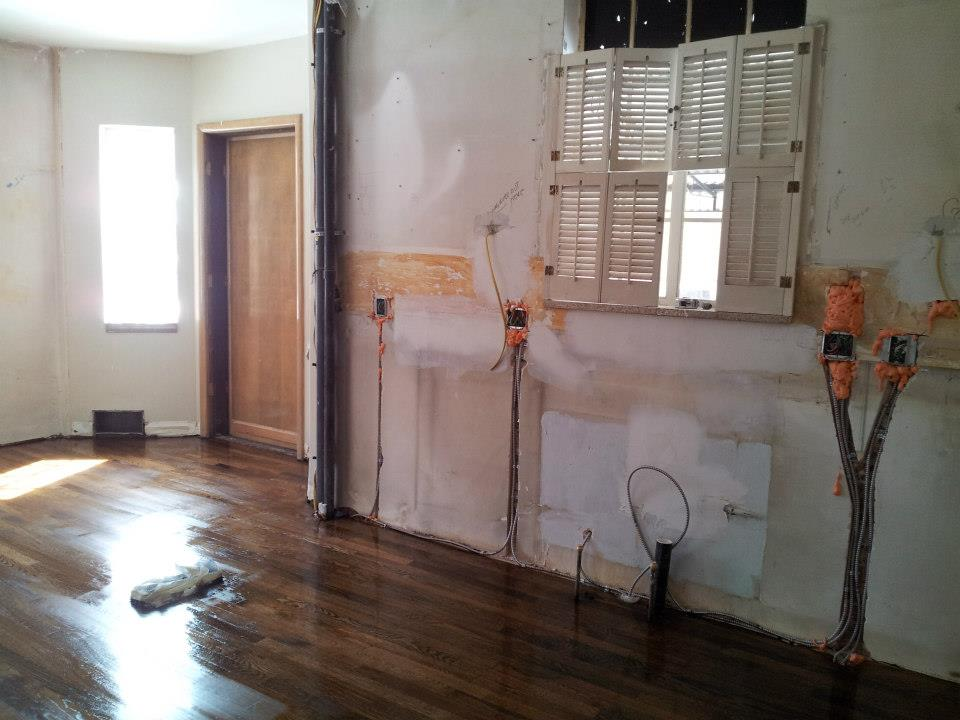 New electrical layout and rough plumbing. Hardwoods patched in.