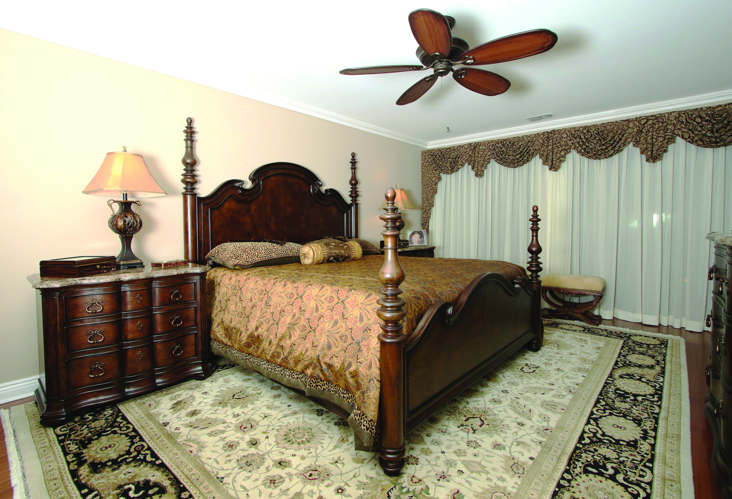 Thomasville furniture enhances a classic bedroom where a Peykar rug adds pattern while keeping with the serenity of the space.