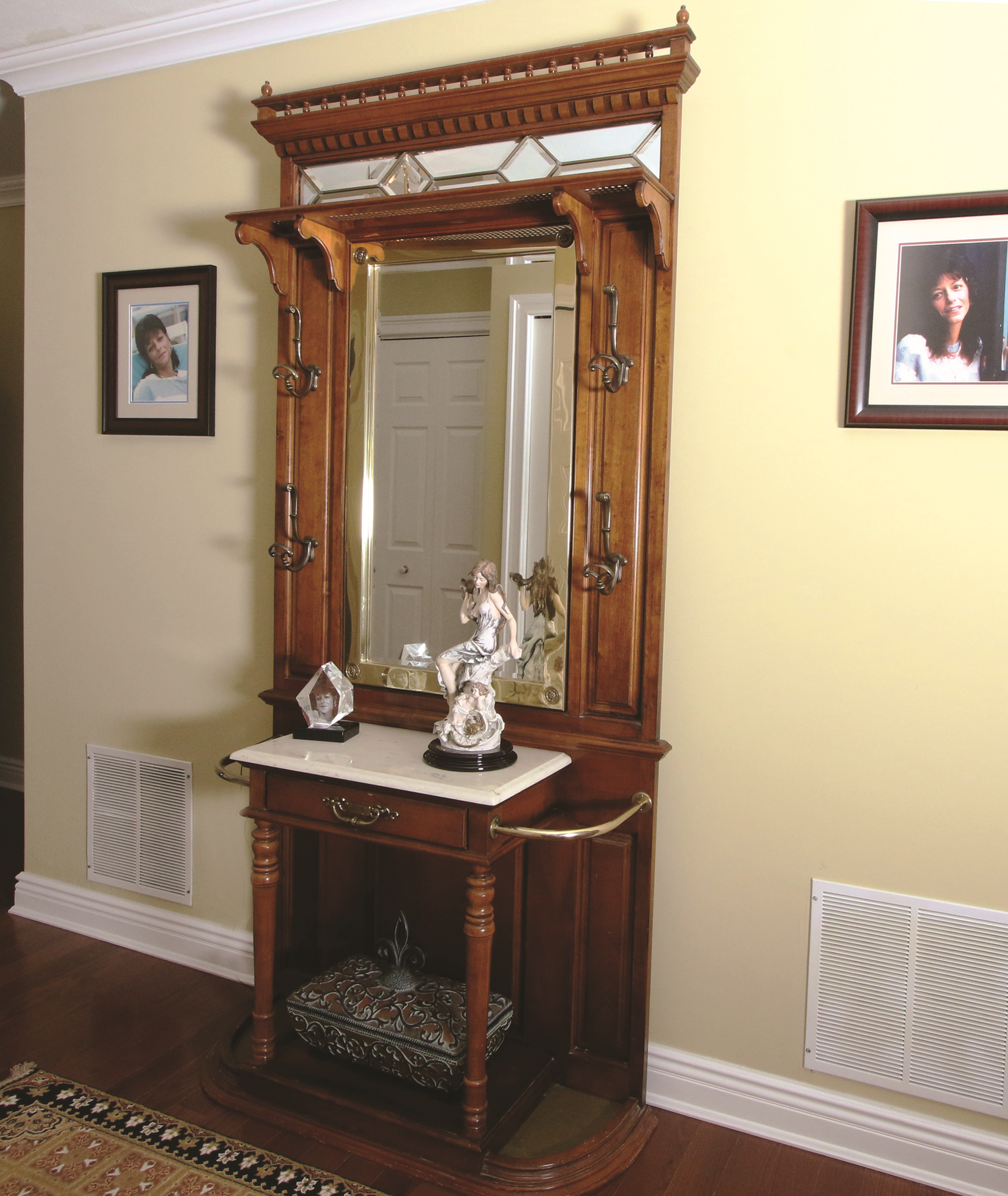 Less is more in this small entry.  Antique hall rack provides a warm yet uncluttered welcome.